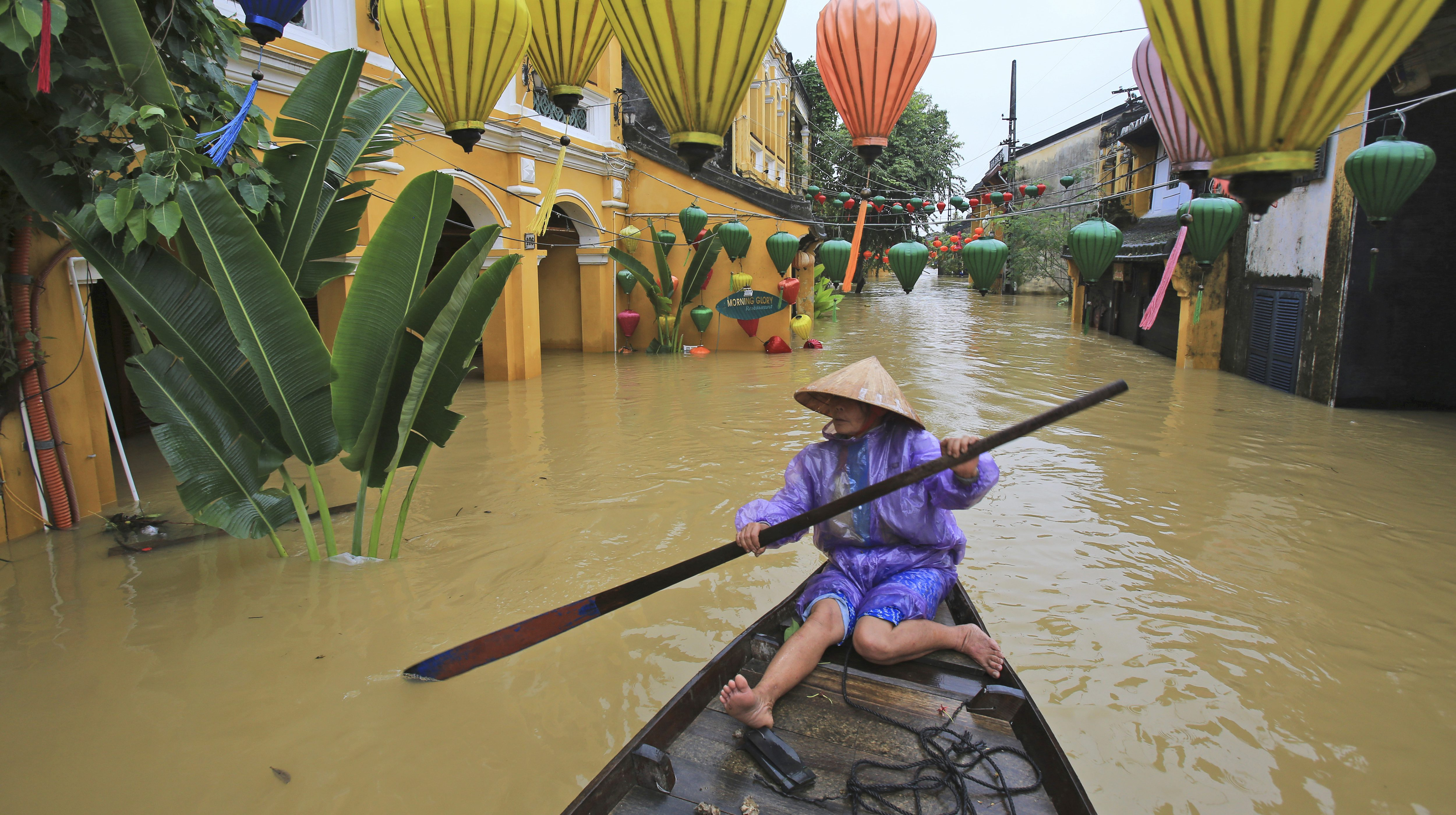 A week before Trump's arrival in Da Nang, Vietnam, Typhoon Damrey left nearby cities like Hoi An heavily flooded.