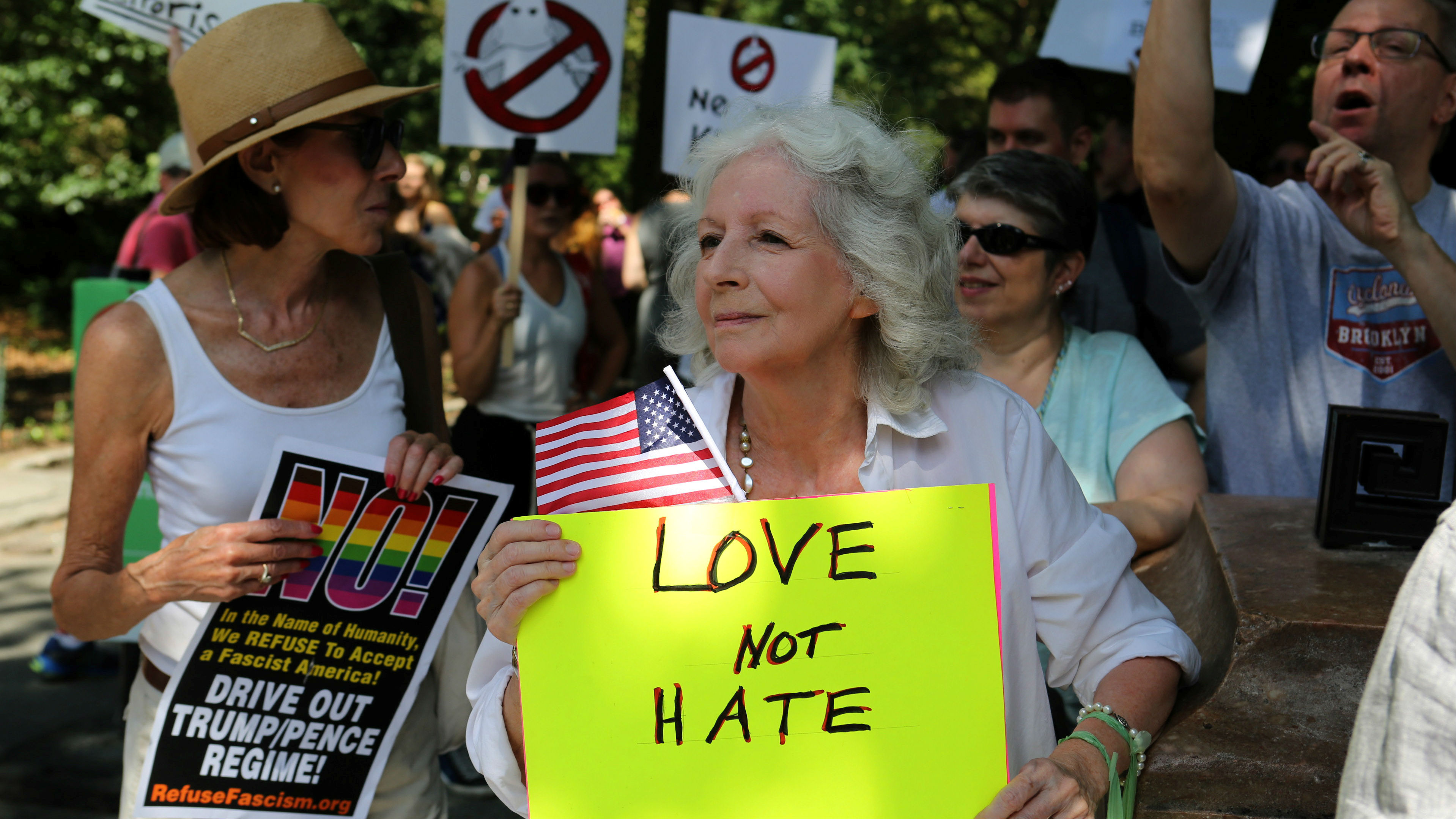 """A protester holds a sign reading """"Love not hate"""" during a march against white nationalism in New York City, the day after the attack on counter-protesters at the """"Unite the Right"""" rally organized by white nationalists in Charlottesville, Virginia, U.S., August 13, 2017."""