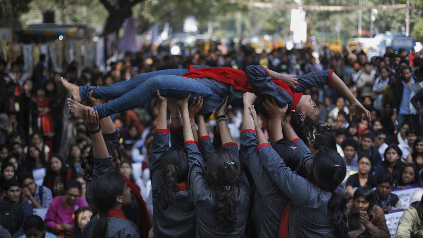 Demonstrators perform a street play on rape during a protest near India's parliament in New Delh