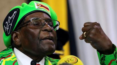 "Tanks roll toward Zimbabwe's capital after army chief threatens to ""step in"""