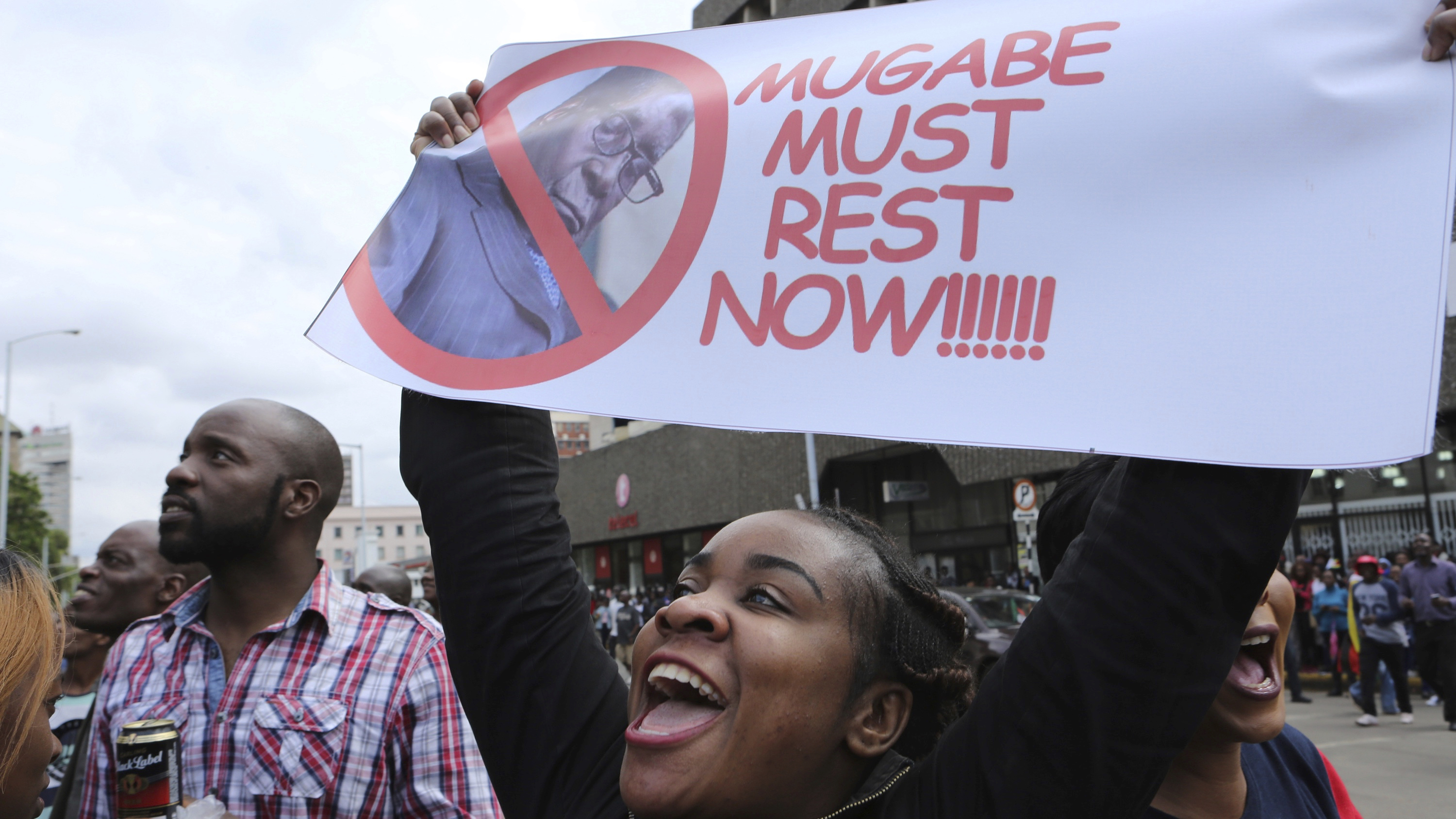 Euphoric crowds  march on the streets of   Harare, demanding the departure  of President Robert Mugabe,  Saturday Nov, 18, 2017.  Zimbabweans giddy with joy raced through interesections, raising their arms in triumph(AP Photo/Tsvangirayi Mukwazhi)