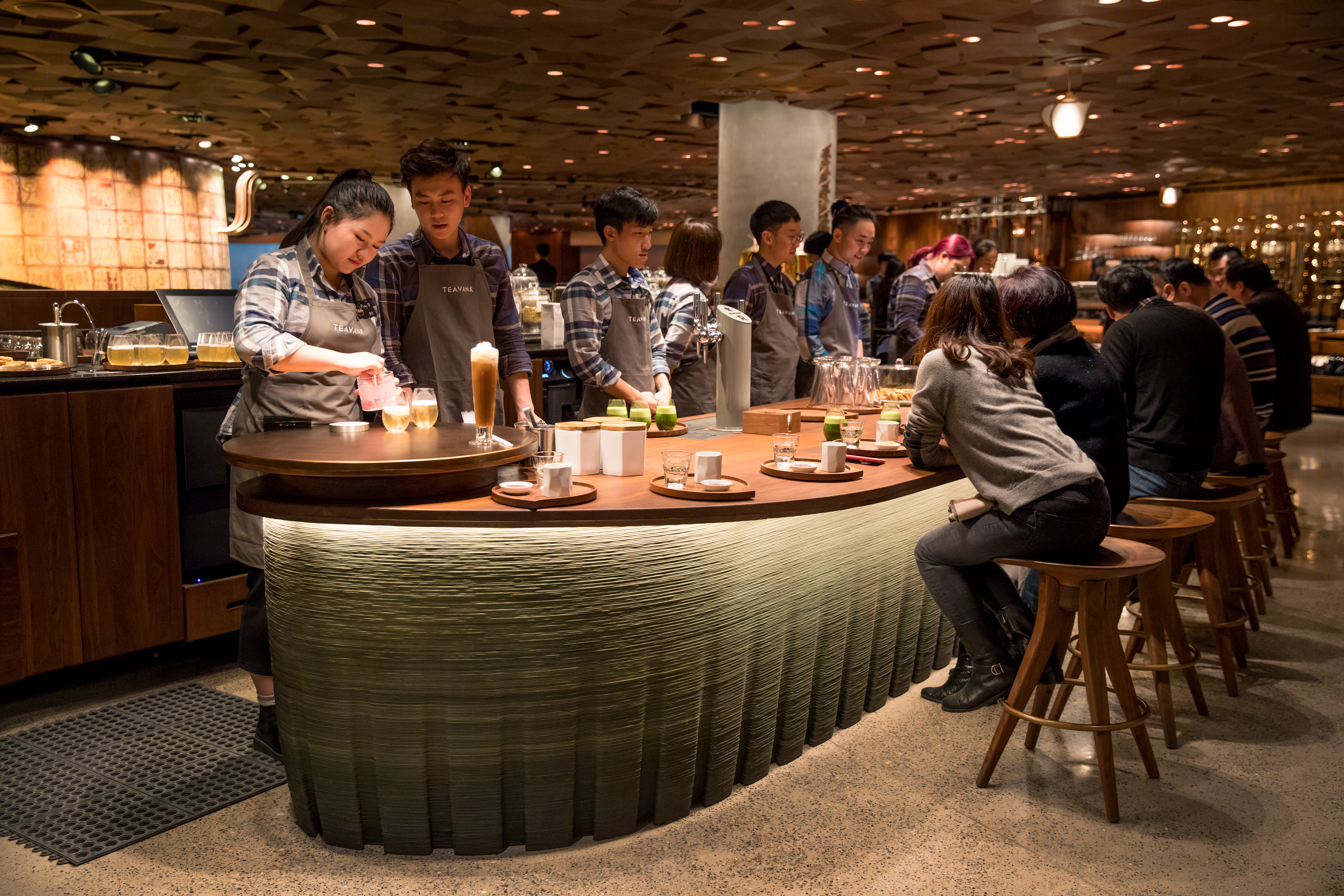 Partners work at the Teavana tea bar in the new Starbucks Roastery in Shanghai, China.