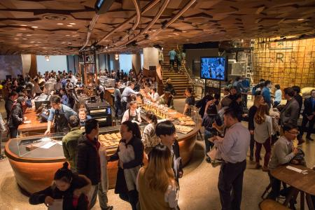 Guests explore the new Starbucks Roastery in Shanghai, China on Sunday, December 3, 2017.