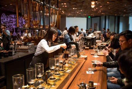 A partner makes a siphon brew in the new Starbucks Roastery in Shanghai, China.