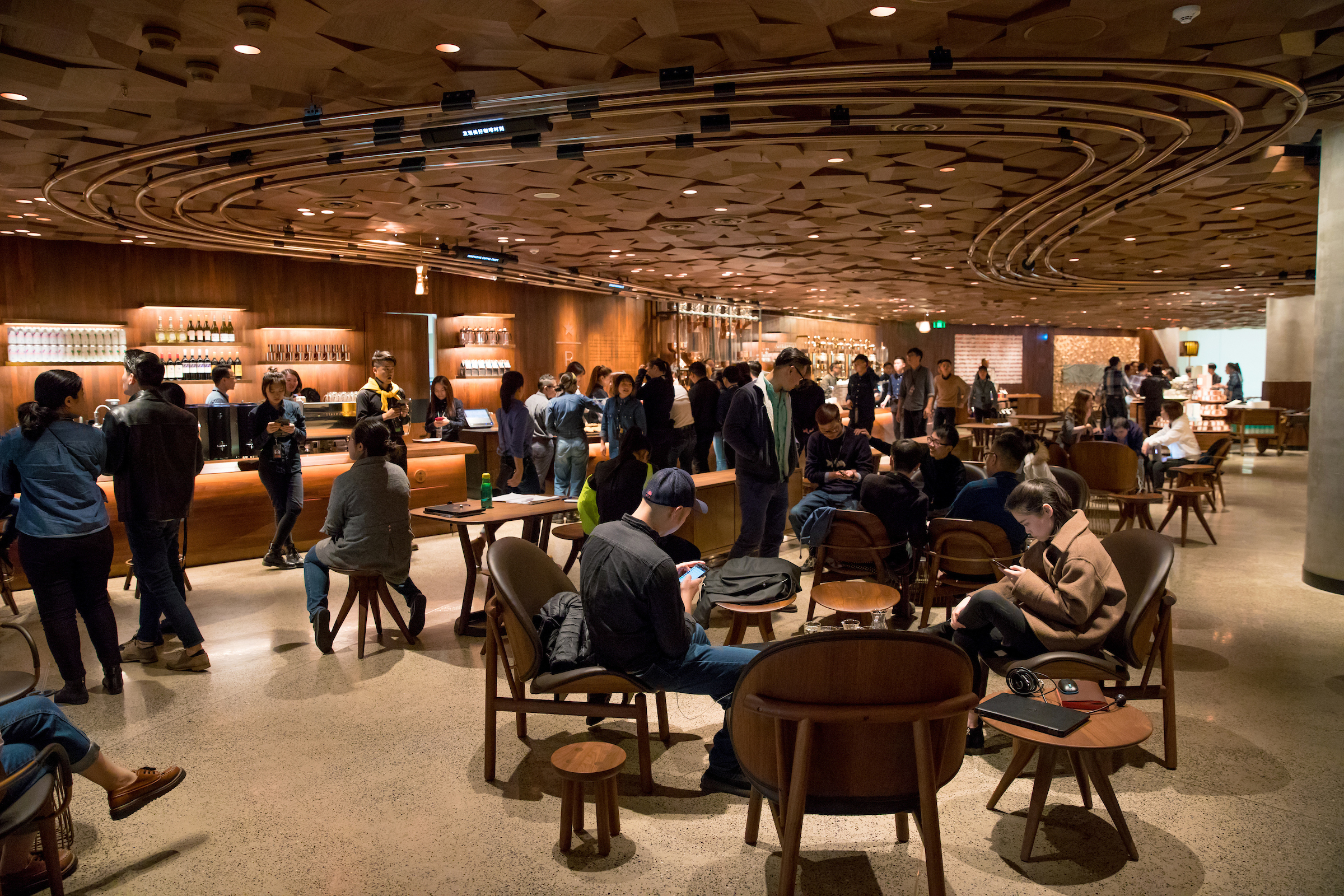 People gather in the new Starbucks Roastery in Shanghai, China.