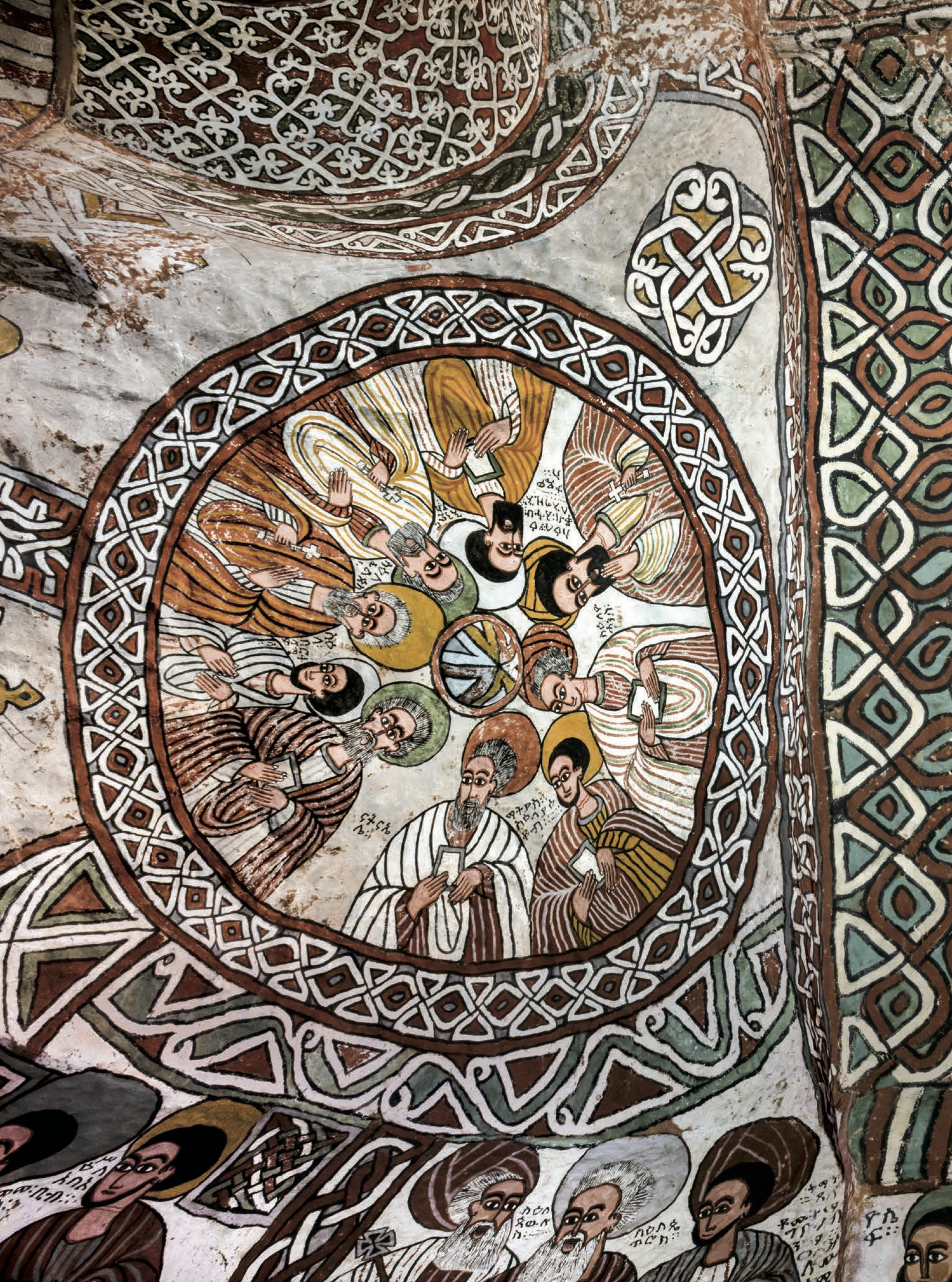 The dry air and lack of humidity has preserved these frescoes in their original perfection. On the left cupola are nine of the Apostles. On the right are eight of the Nine Saints. Clockwise from the bottom: Aragawi, Alef, Guba, Tsehema, Pantalewon, Garima, Likanos, and Aftse.