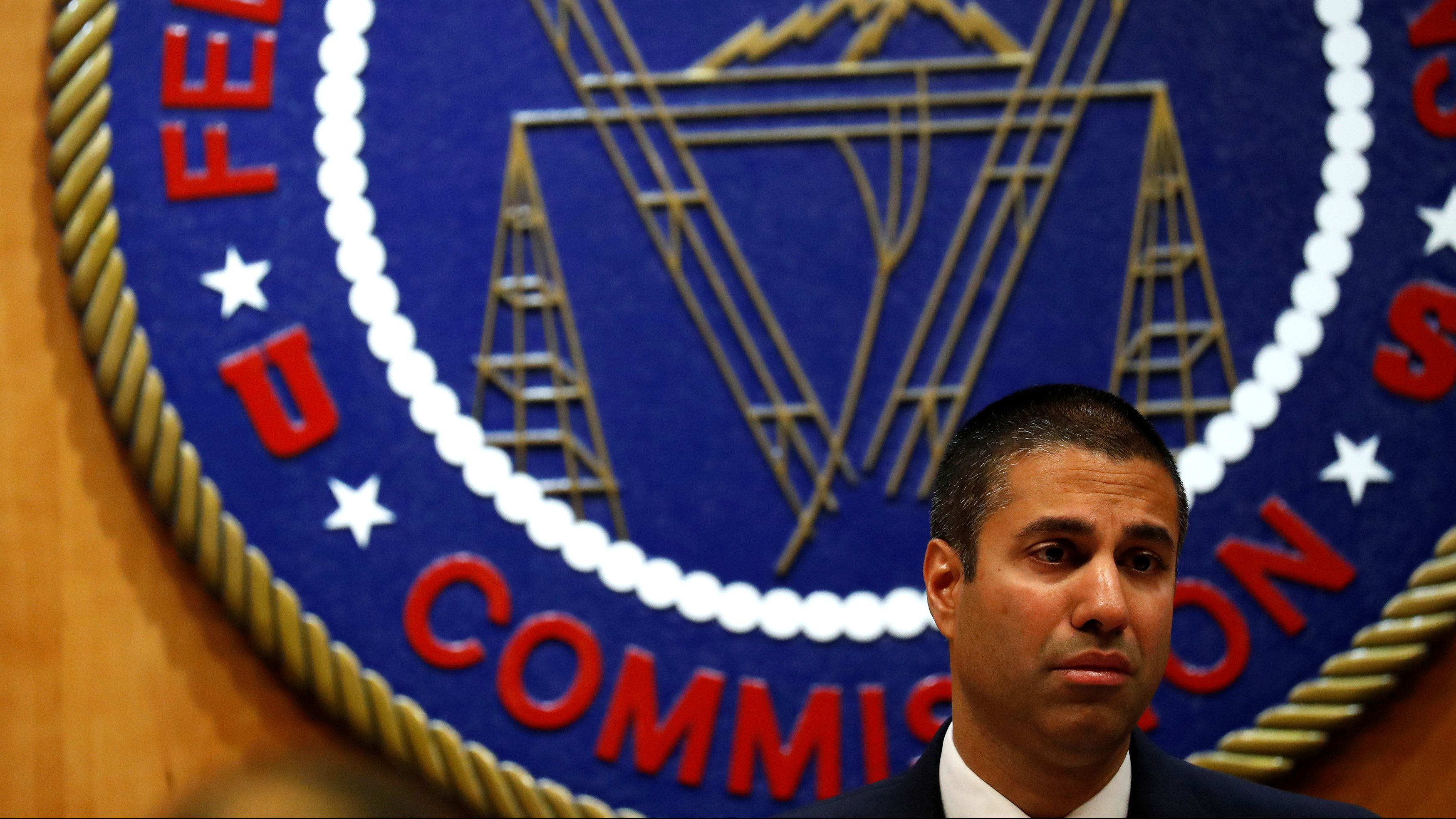 Chairman Ajit Pai speaks ahead of the vote on the repeal of so called net neutrality rules at the Federal Communications Commission in Washington, U.S., December 14, 2017. REUTERS/Aaron P. Bernstein - RC1ED2FADBB0