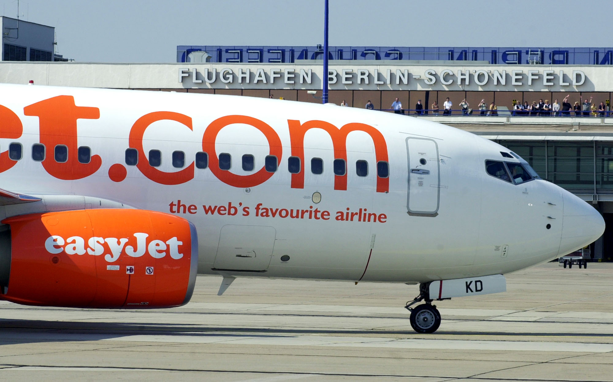 An Airbus A319 plane of British low-cost airline ''easyJet'' rolls on the tarmac pass the terminal building of the Berlin Schoenefeld airport after its first landing here on Wednesday afternoon, April 28, 2004. ''easyJet'' plans to establish 13 destinations in Europe from Schoenefeld in the next six weeks making the former Communist East German GDR airport the airline's biggest base outside the UK.