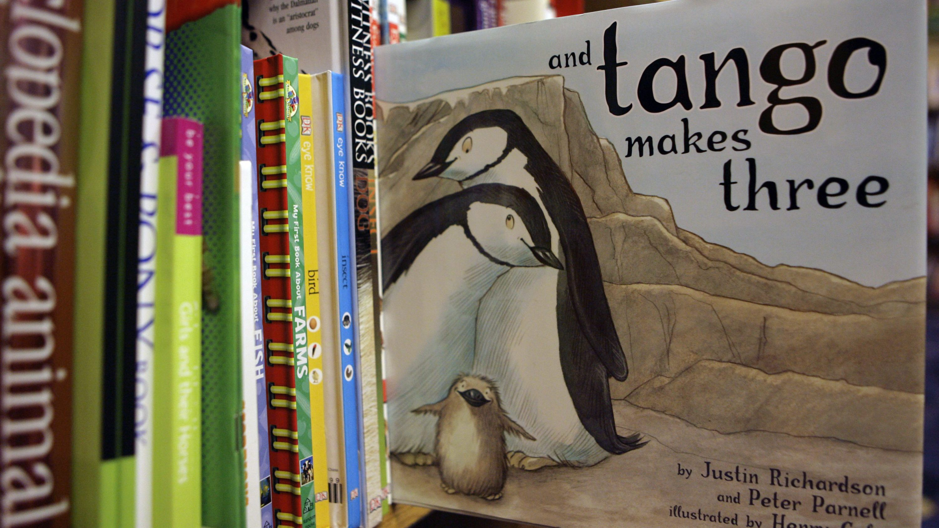 The picture book based on a true story about two male penguins that raise an adopted hatchling together has been ordered off bookshelves in the Charlotte-Mecklenburg Schools in North Carolina after parent inquiries, officials said. The ban came in a Nov. 30 memo from district administrators to school principals and library staff.