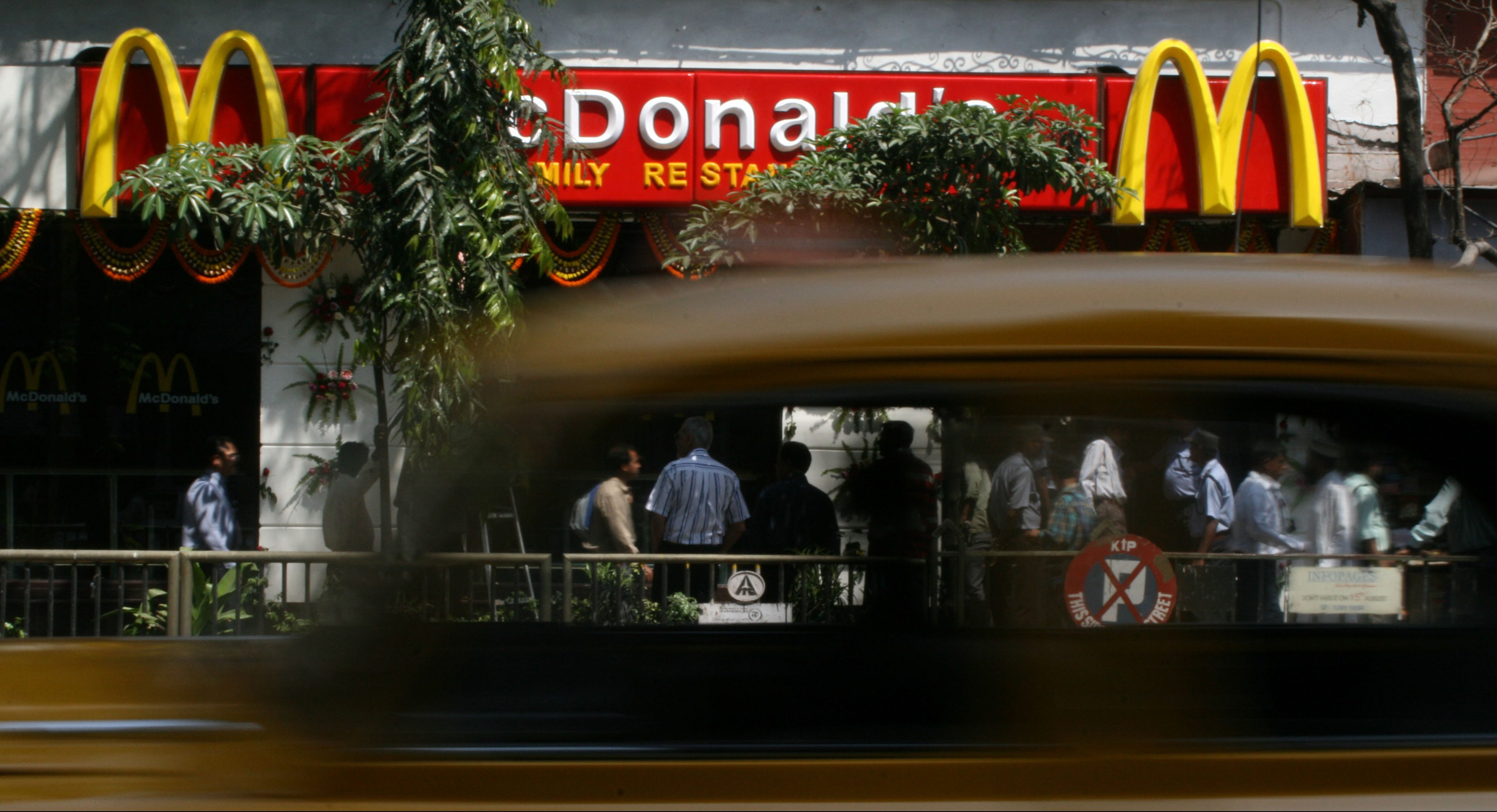 A car speeds past the McDonald's family restaurant in Calcutta, Thursday, March 8, 2007. By opening this first outlet in the eastern India, McDonald's announced plans to invest Rupees 100 crores (22.22 Million U S Dollars) n the region, according to a press release. (AP Photo/Bikas Das)
