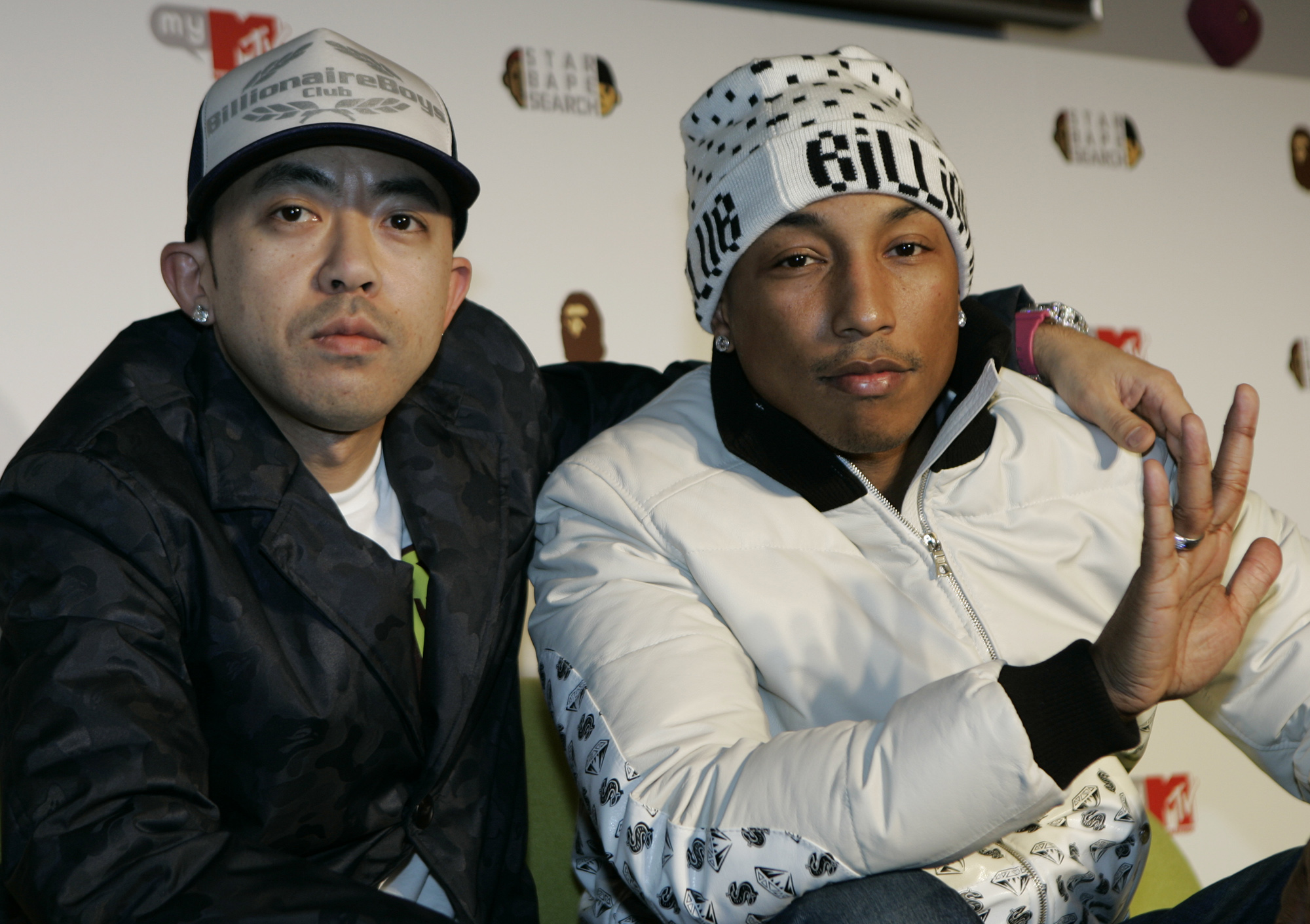 "Hip-pop/R&B star Pharrell Williams of the Neptunes, right, and A Bathing Ape producer Nigo pose for photographers at a press conference to launch ""Star Bape Search"" audition to look for new Japanese artists in Tokyo, Japan, Monday, Feb. 18, 2008. (AP Photo/Shizuo Kambayashi)"