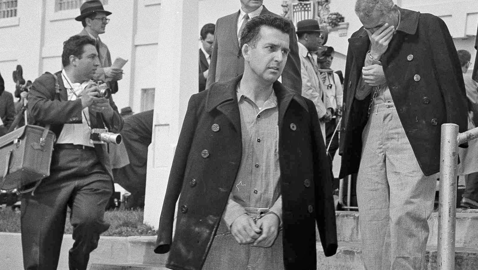 """Some of the 27 prisoners removed from Alcatraz Prison are shown just before boarding the launch that brought them to the mainland for removal to other prisons, March 21, 1963. The removal of the last prisoners closed """"The Rock"""" as a federal prison for the nation's toughest criminals. Alcatraz, located in San Francisco Bay, was a federal penitentiary for 29 years and a prison for more than a century. Prisoners are all handcuffed and wear leg irons. (AP Photo/Robert W. Klein)"""