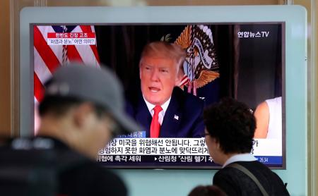 "Trump's ""fire and fury"" comments are reported on South Korean TV."