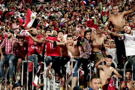 "In this Sunday, Oct. 8, 2017 file photo, Egyptian fans celebrate after their win over Congo during the 2018 World Cup group E qualifying soccer match in Alexandria, Egypt. ""Youm7,"" or Seventh Day, a Cairo daily, said in an article in the newspaper's online edition Wednesday, Oct. 18, 2017, that Egypt's qualification at next year's World Cup has made many male fans dream about traveling to Russia to meet local women and is warning them they should lower their expectations about meeting Russian women."