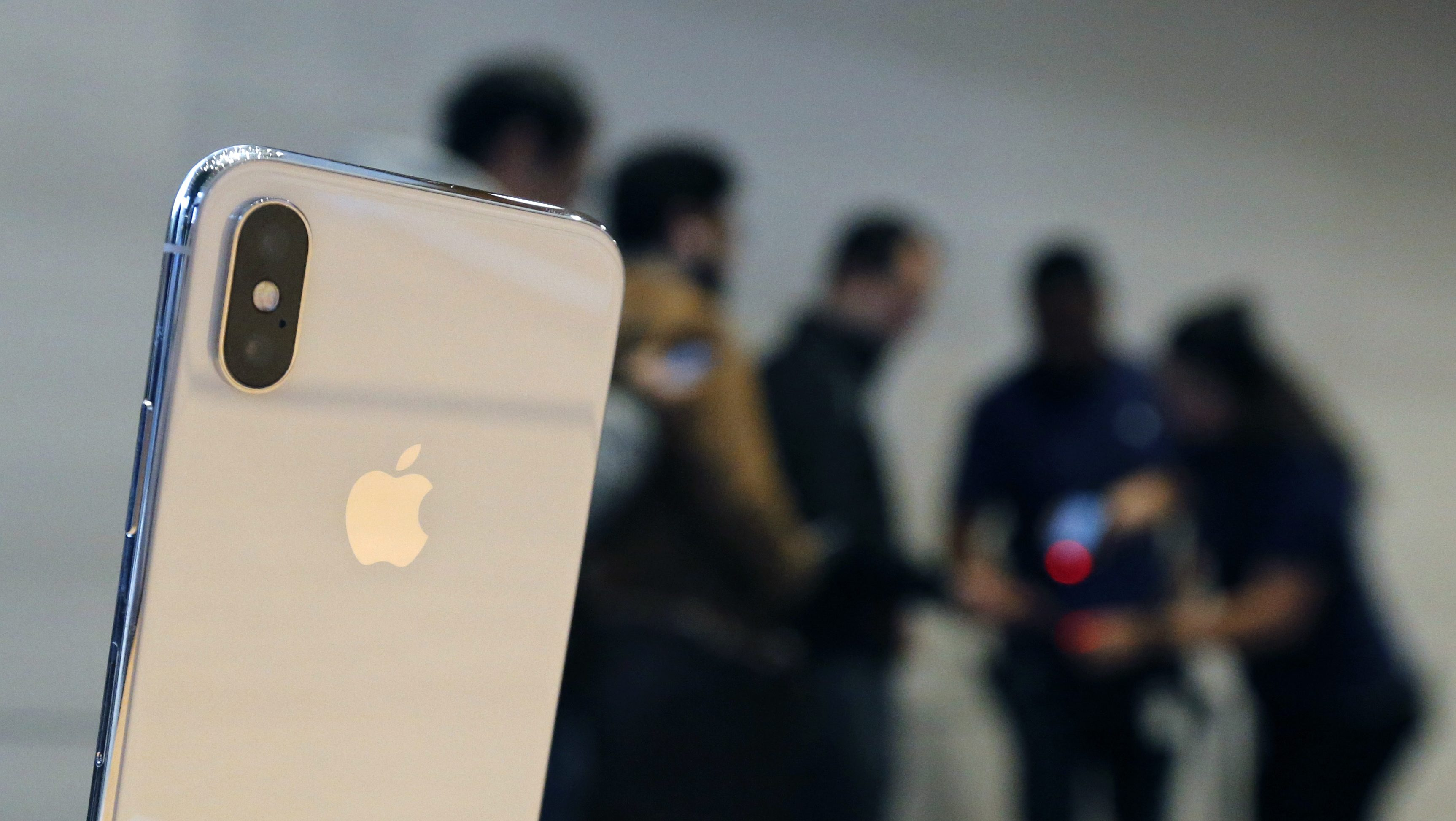 The new Apple iPhone X sits on display as consumers line up to buy the phone at the new Apple Michigan Avenue store along the Chicago River Friday, Nov. 3, 2017, in Chicago. (AP Photo/Charles Rex Arbogast)
