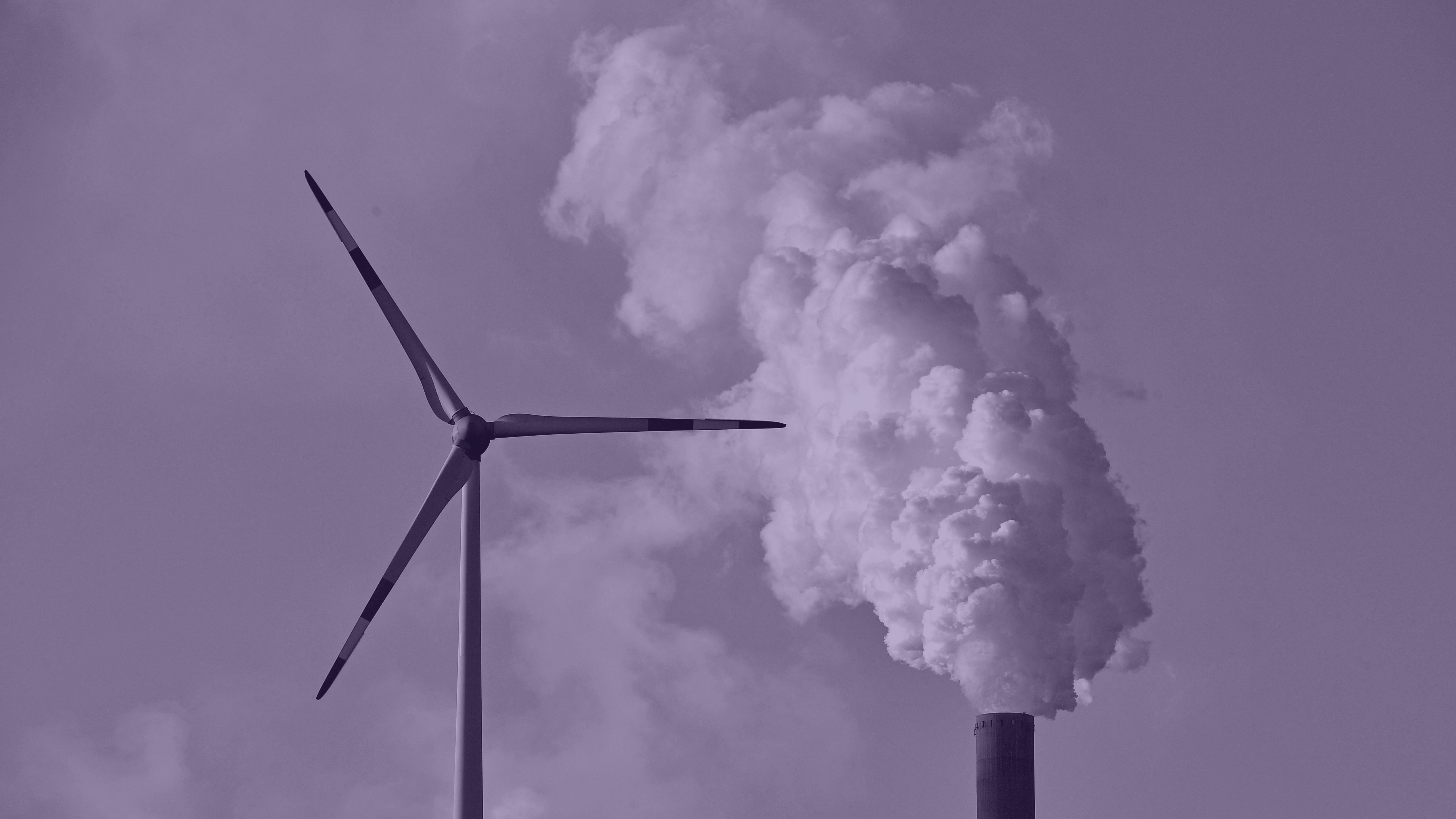A coal-burning power plant steams behind wind generators in Gelsenkirchen, Germany while the 23rd UN Conference of the Parties (COP) climate talks end in Bonn, Germany, Friday, Nov. 17, 2017. (AP Photo/Martin Meissner)