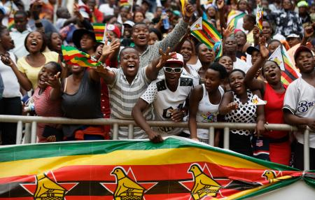 Spectators cheer from the stands at the inauguration ceremony of President Emmerson Mnangagwa in the capital Harare, Zimbabwe Friday, Nov. 24, 2017. Mnangagwa was sworn in as Zimbabwe's president after Robert Mugabe resigned on Tuesday, ending his 37-year rule.