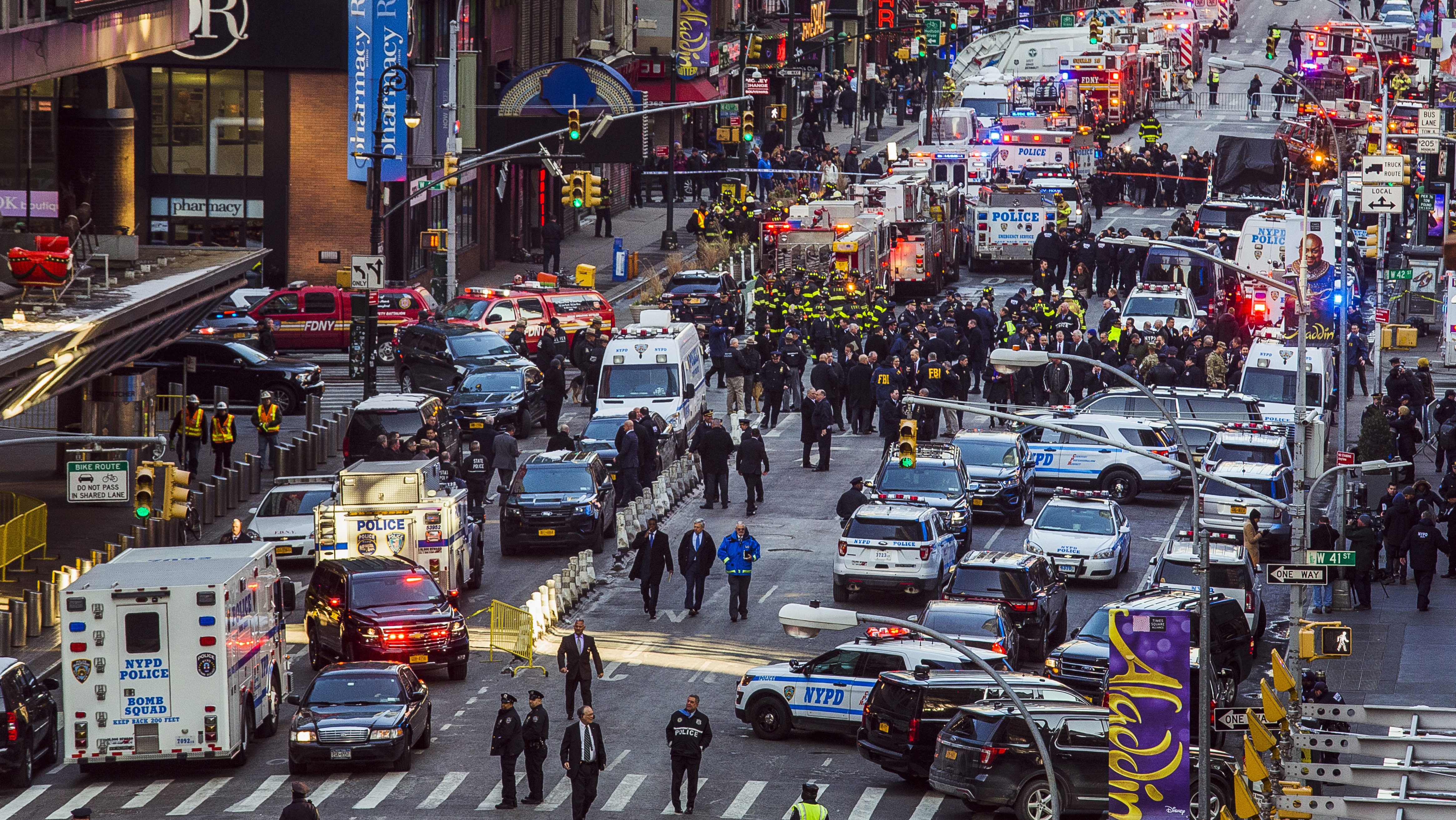 Law enforcement officials work following an explosion near New York's Times Square on Monday, Dec. 11, 2017. Police said a man with a pipe bomb strapped to his body set off the crude device in a passageway under 42nd Street between Seventh and Eighth Avenues. (AP Photo/Andres Kudacki)