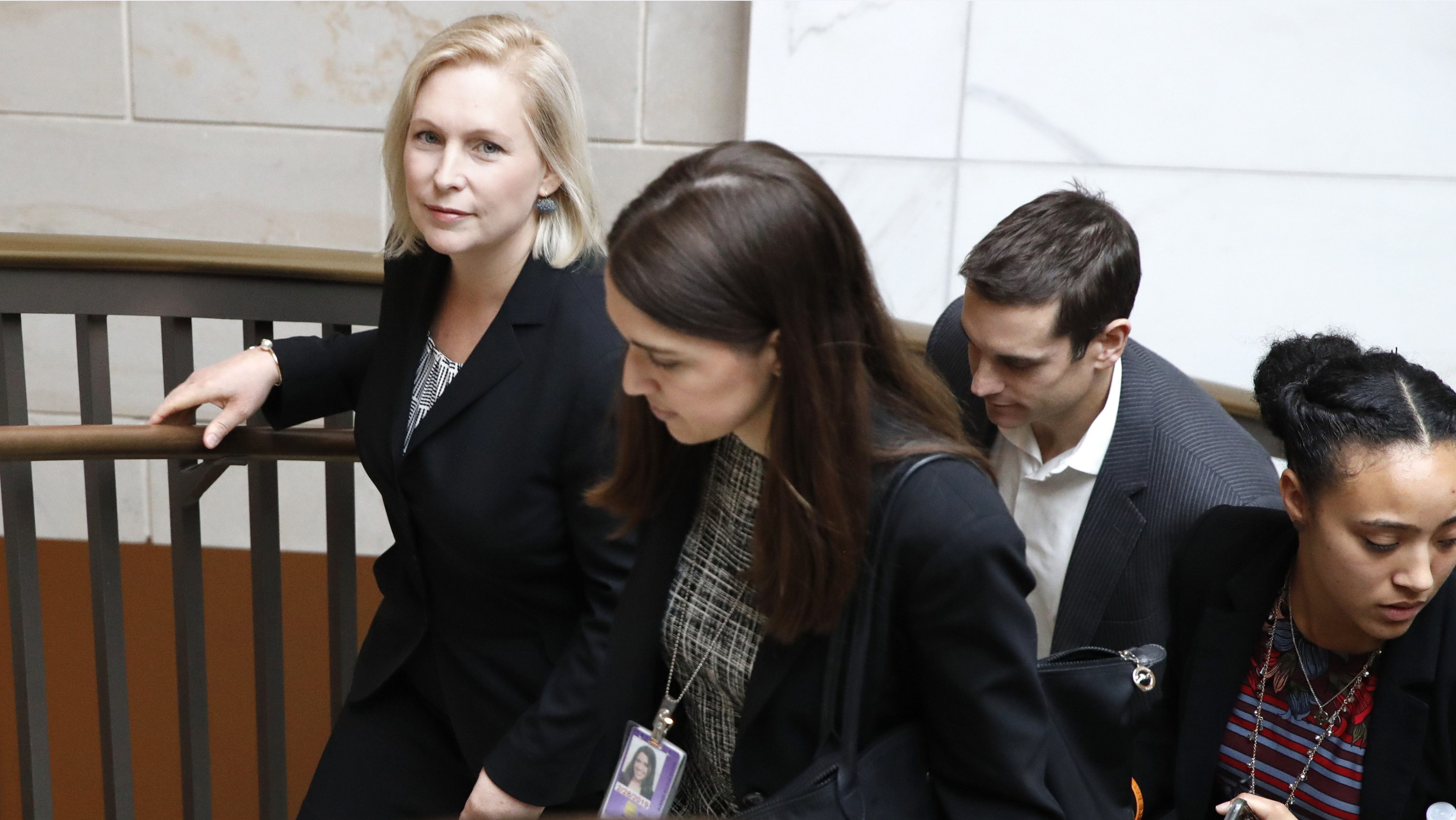 """Sen. Kirsten Gillibrand, D-N.Y., left, walks up a staircase after attending a news conference, Tuesday, Dec. 12, 2017, on Capitol Hill in Washington.  Gillibrand says President Donald Trump's latest tweet about her was a """"sexist smear"""" aimed at silencing her voice.   (AP Photo/Jacquelyn Martin)"""