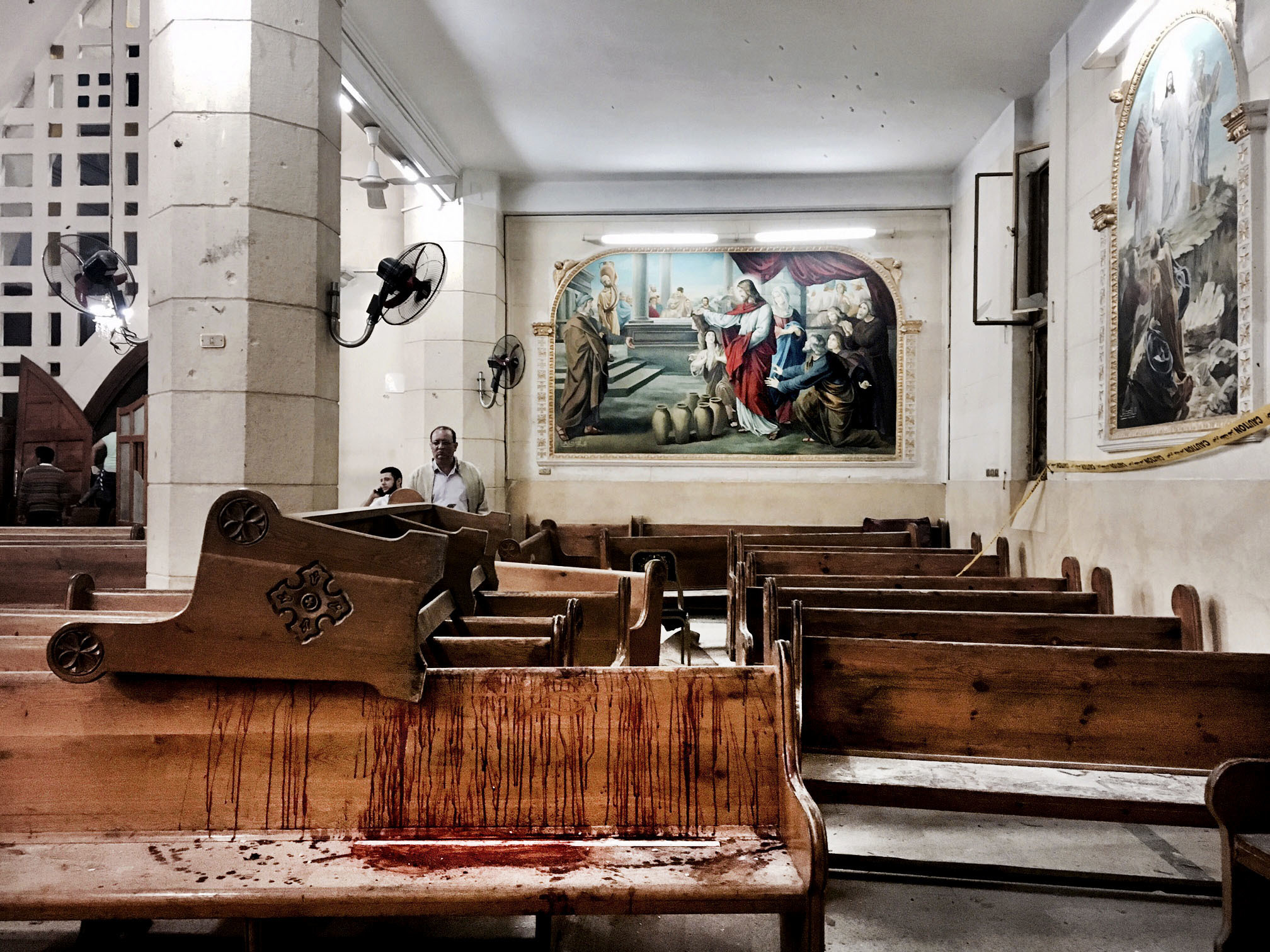 Blood stains pews inside the St. George Church after a suicide bombing, in the Nile Delta town of Tanta, Egypt, Sunday, April 9, 2017. Bombs exploded at two Coptic churches in the northern Egyptian cities of Tanta and Alexandria as worshippers were celebrating Palm Sunday, killing over 40 people and wounding scores more in assaults claimed by the Islamic State group.