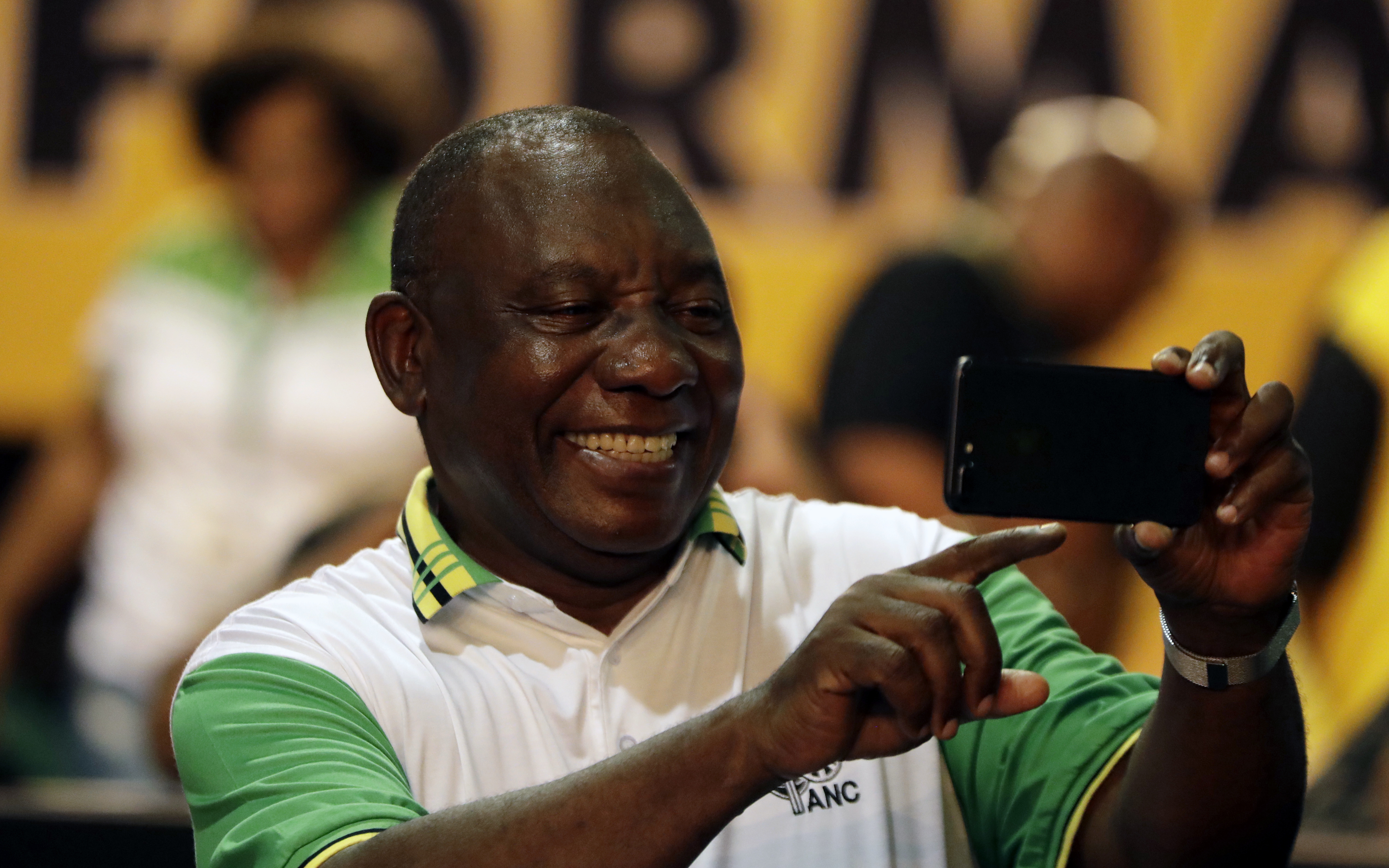 The newly elected African National Congress (ANC) President, Cyril Ramaphosa, takes a selfie after it was announced that he had won the vote at the ANC's elective conference in Johannesburg, Monday Dec. 18, 2017. Outgoing President Jacob Zuma's second and final term as party leader has ended after a scandal-ridden tenure that has seen a plummet in the popularity of Nelson Mandela's liberation movement.