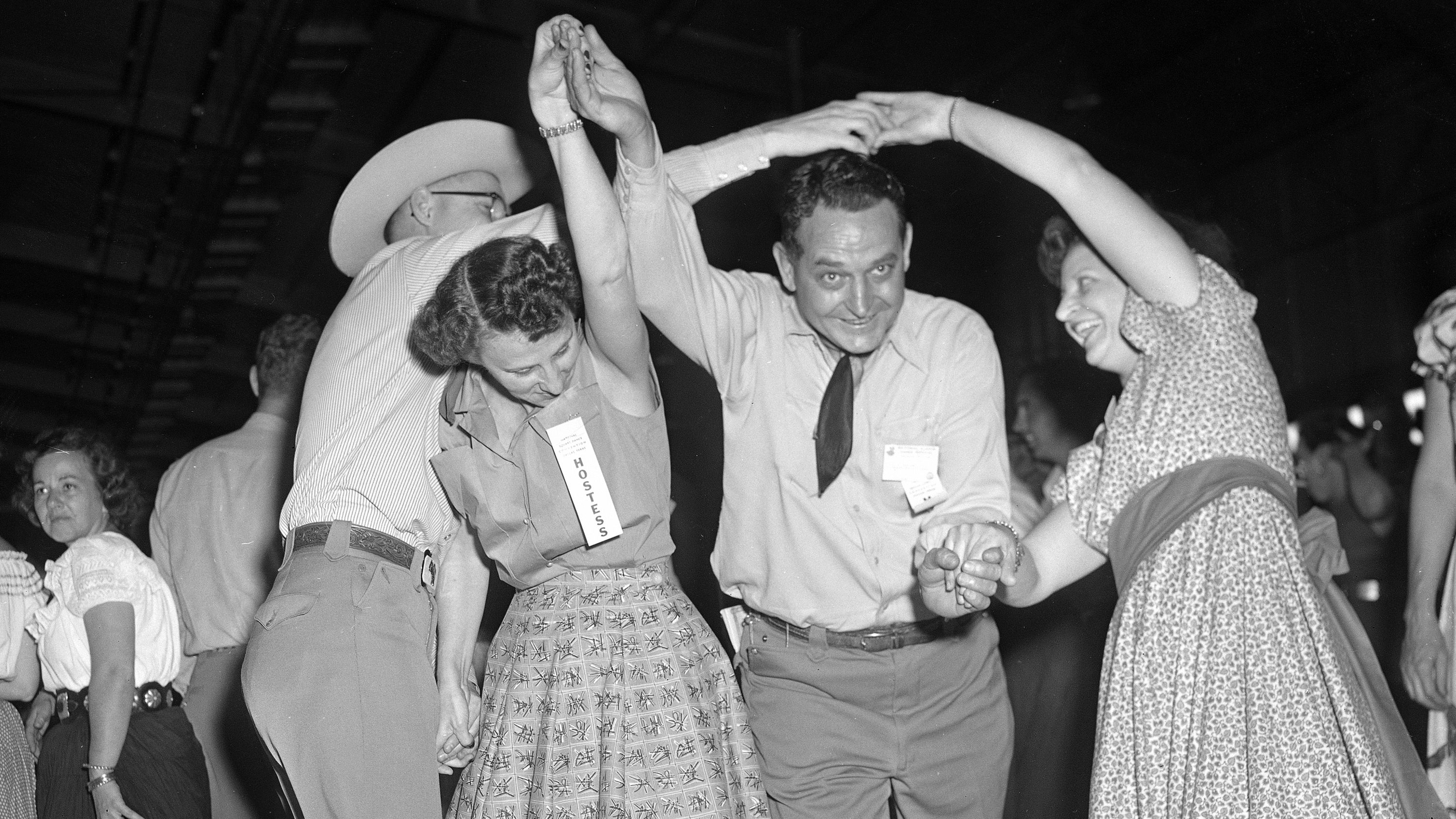 From early morning until 1 am, square dancers from the U.S. and Canada sway and swing at the third annual National Square Dance convention under way in Dallas, Texas, April 8, 1954. From left: Denis Donovan of Vancouver; Mrs. and Mr. C.M. McKinney of Corpus Christi; and Julia Winkler of Milwaukee. The three-day convention ends Saturday.