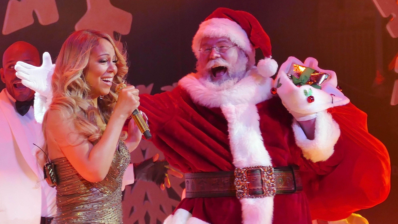 Mariah Carey and Santa Clause performing together.
