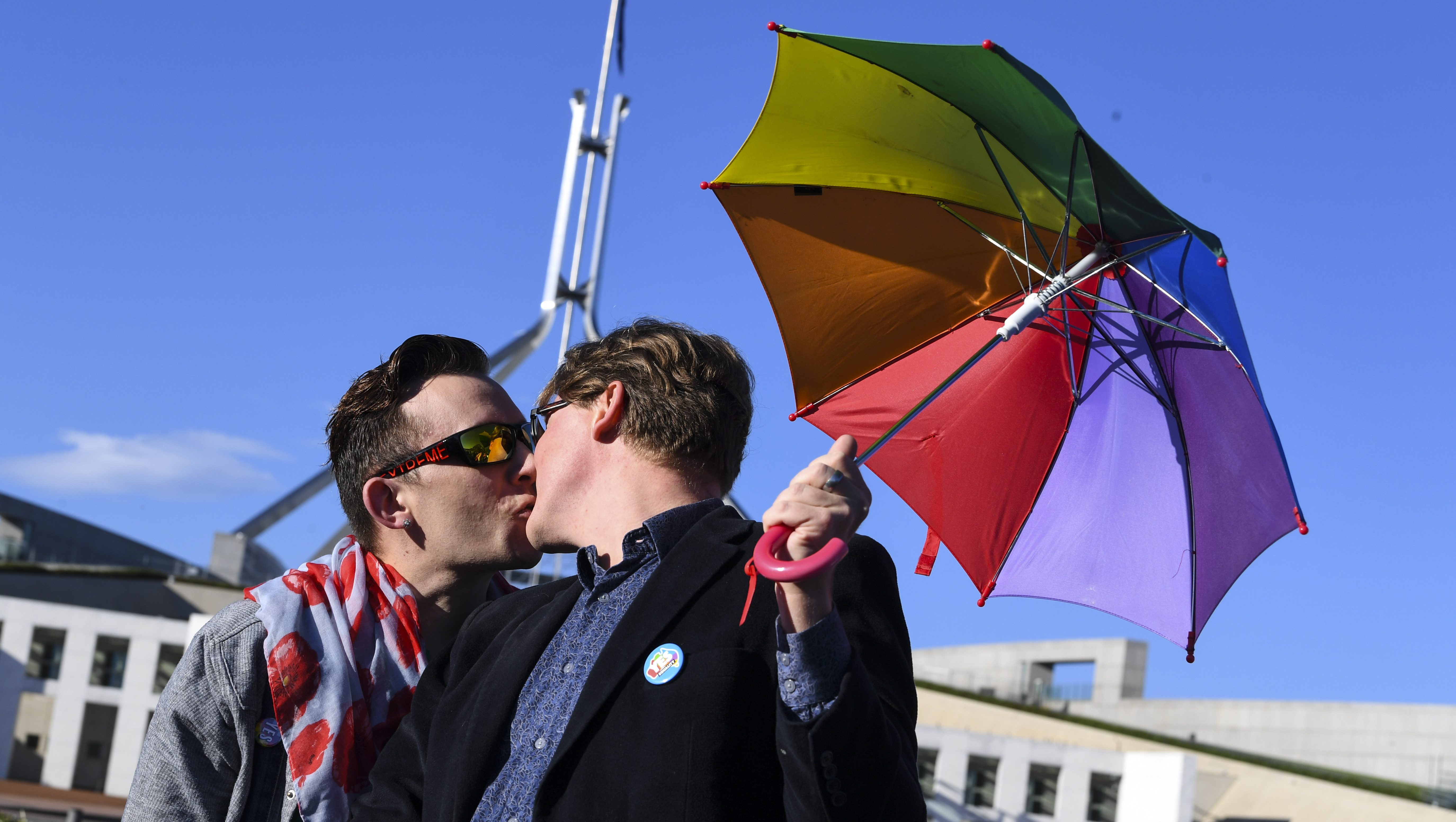 A couple kisses outside Parliament House during an equality rally in Canberra, Australian Capital Territory, Australia, 07 December 2017.  A bill allowing same-sex couples to marry could see its historic pass on the day as the Australian parliament is on its final sitting.  EPA-EFE