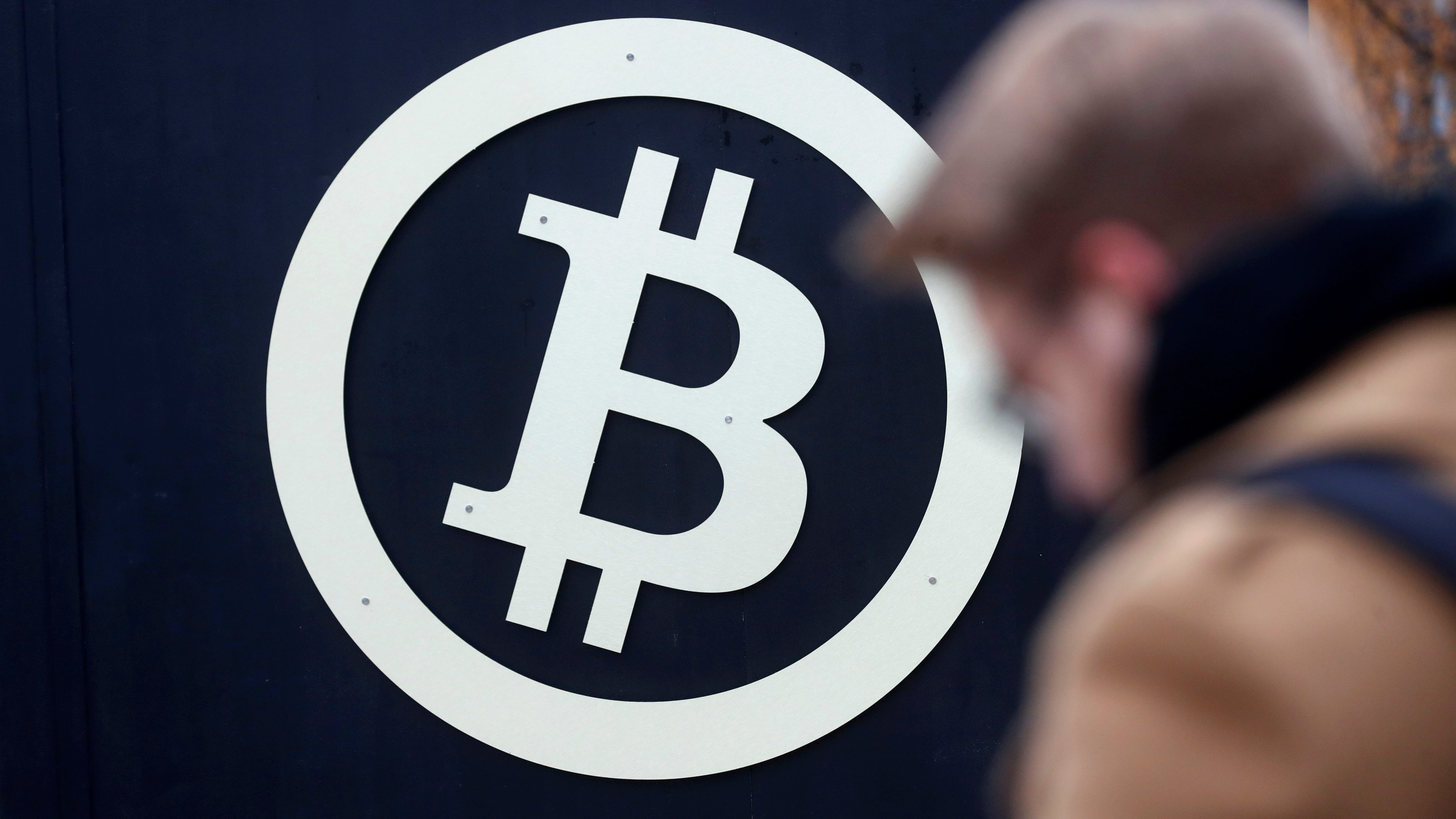 A bitcoin sign is seen during Riga Comm 2017, a business technology and innovation fair in Riga, Latvia November 9, 2017.