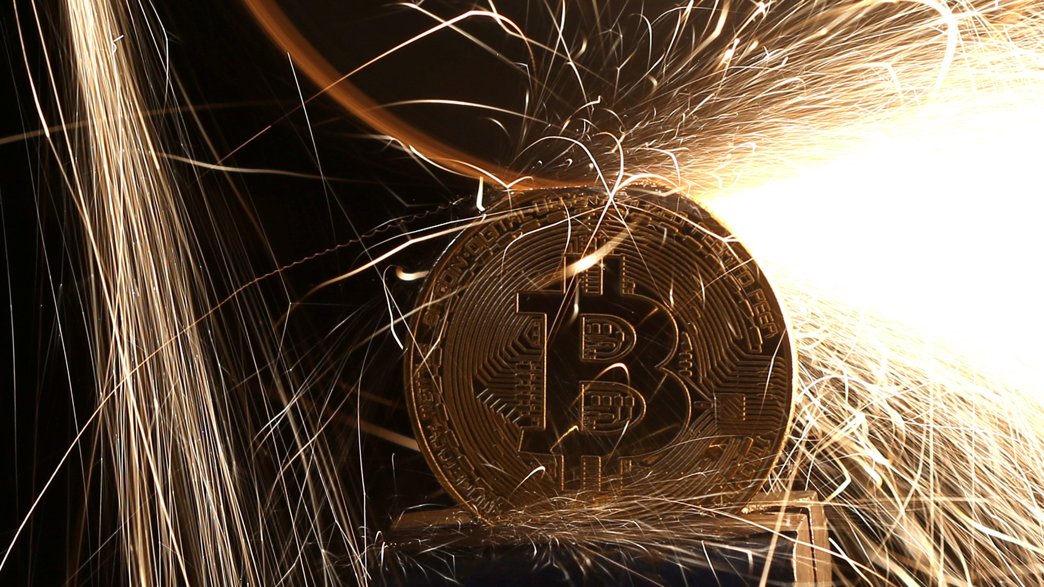 Sparks glow from broken Bitcoin (virtual currency) coins in this illustration picture, December 8, 2017. Picture taken December 8.