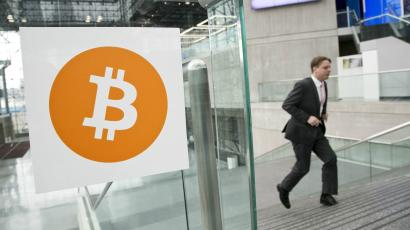 A man arrives for the Inside Bitcoins conference and trade show in New York.