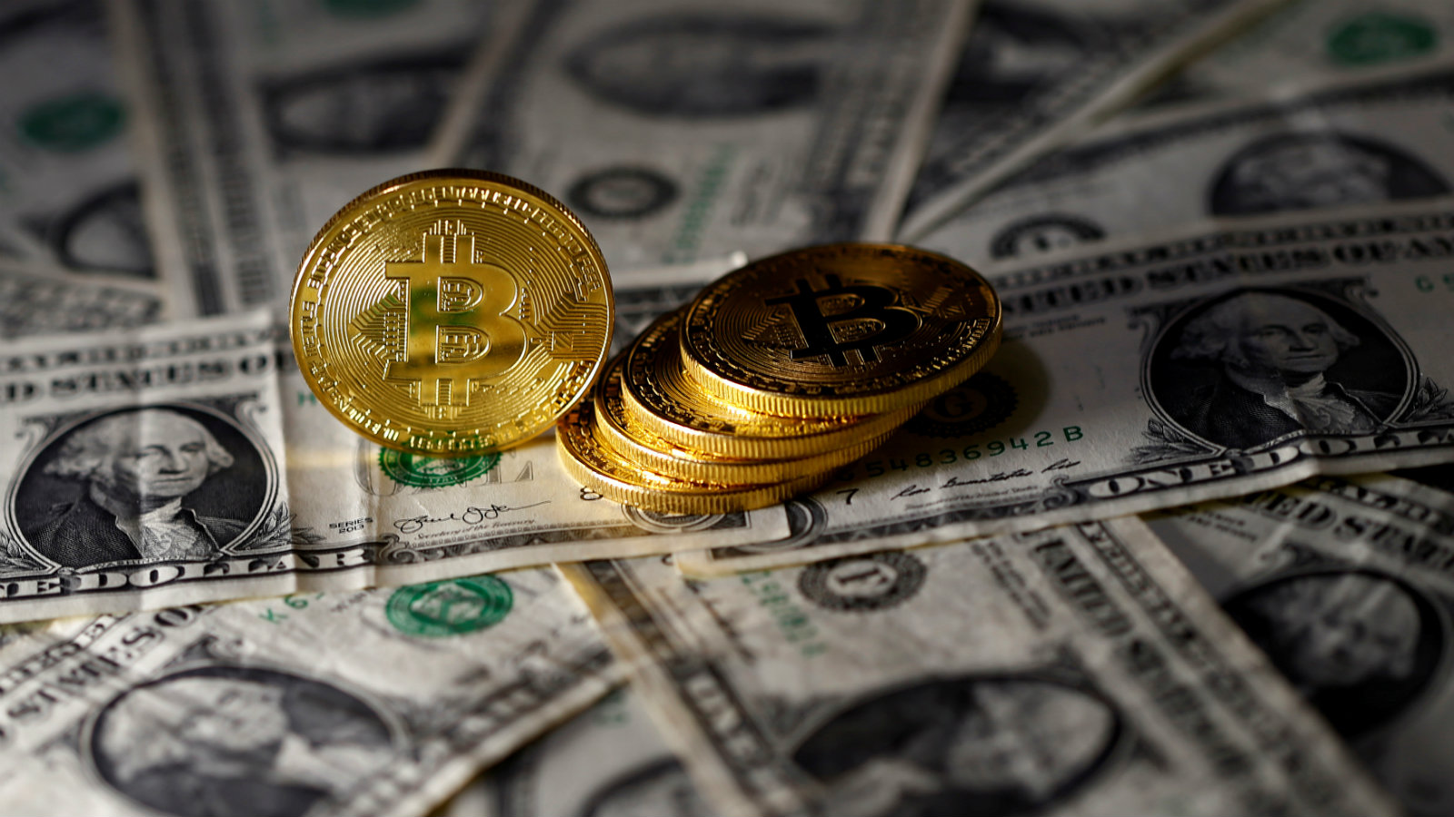Bitcoin (virtual currency) coins placed on Dollar banknotes are seen in this illustration...