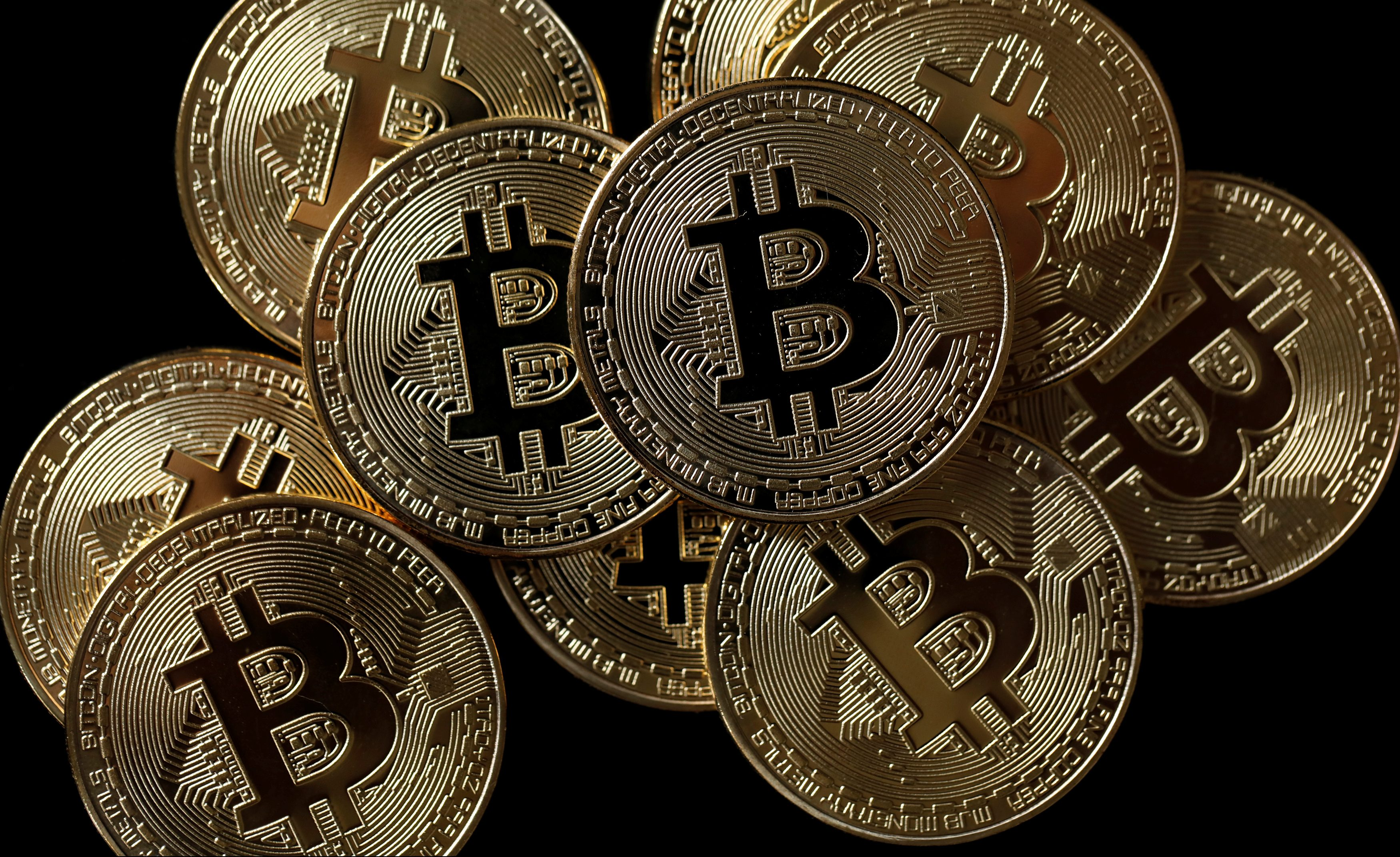 A collection of Bitcoin (virtual currency) tokens are displayed in this picture illustration taken December 8, 2017.