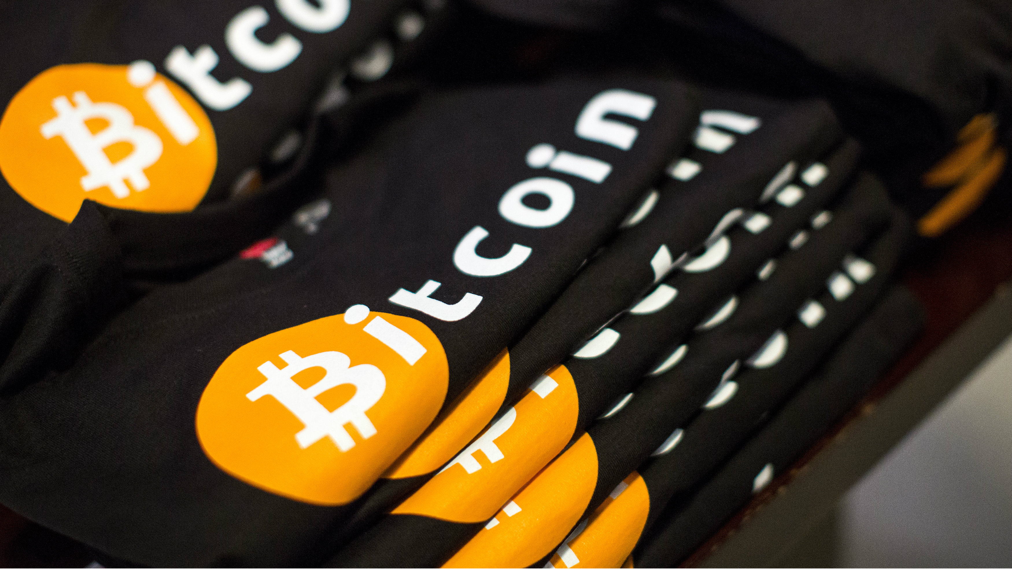 Shirts are displayed, for sale, during the Satoshi Square at the Bitcoin Center NYC in New York May 22, 2014. Satoshi Square is the World's Largest Direct Sellers-to-Buyers Bitcoin trading pit at the Bitcoin Center NYC, located a block from the New York Stock Exchange in New York's financial district.