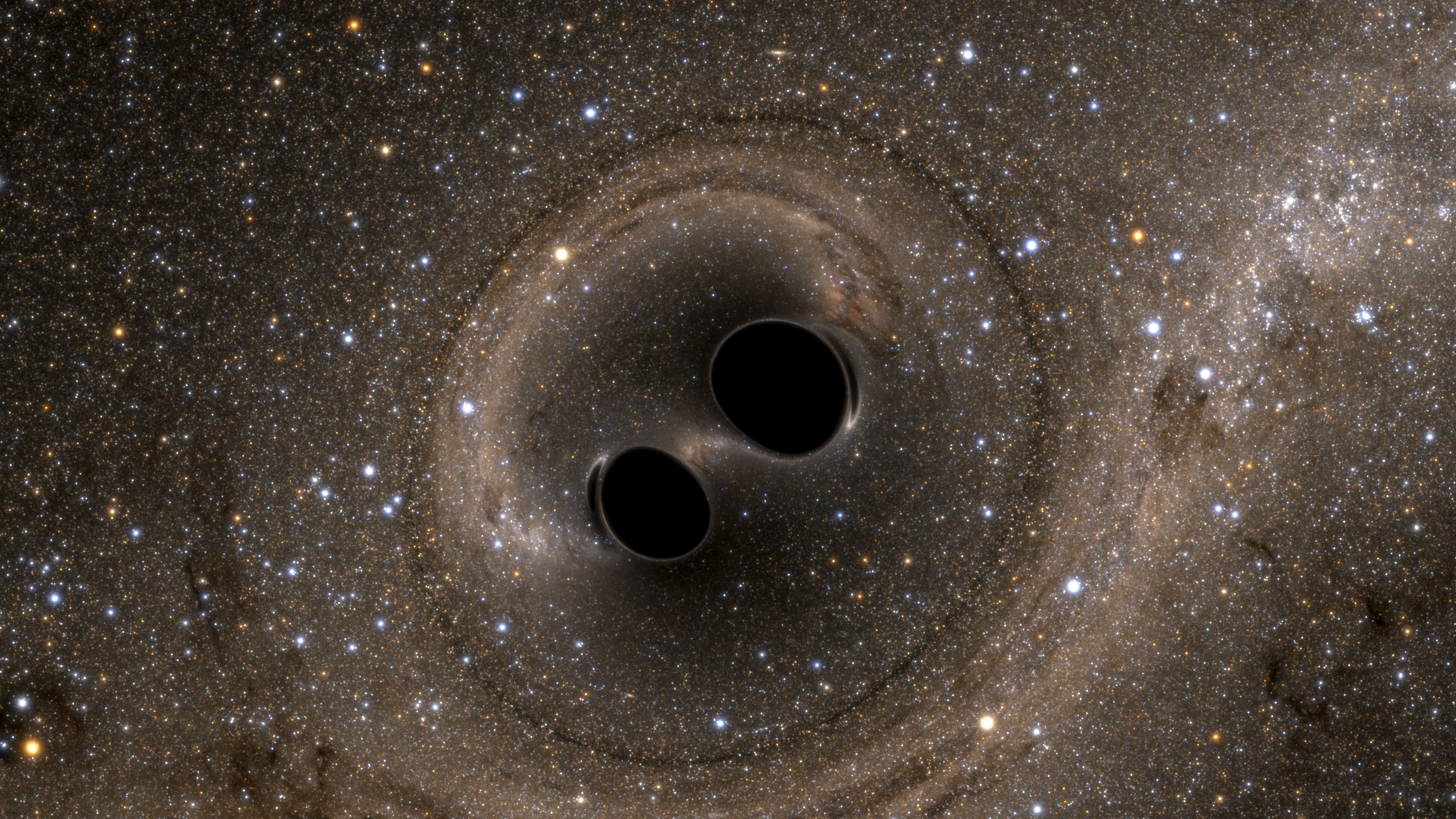 The collision of two black holes holes - a tremendously powerful event detected for the first time ever by the Laser Interferometer Gravitational-Wave Observatory, or LIGO - is seen in this still image from a computer simulation released in Washington February 11, 2016. Scientists have for the first time detected gravitational waves, ripples in space and time hypothesized by Albert Einstein a century ago, in a landmark discovery announced on Thursday that opens a new window for studying the cosmos.
