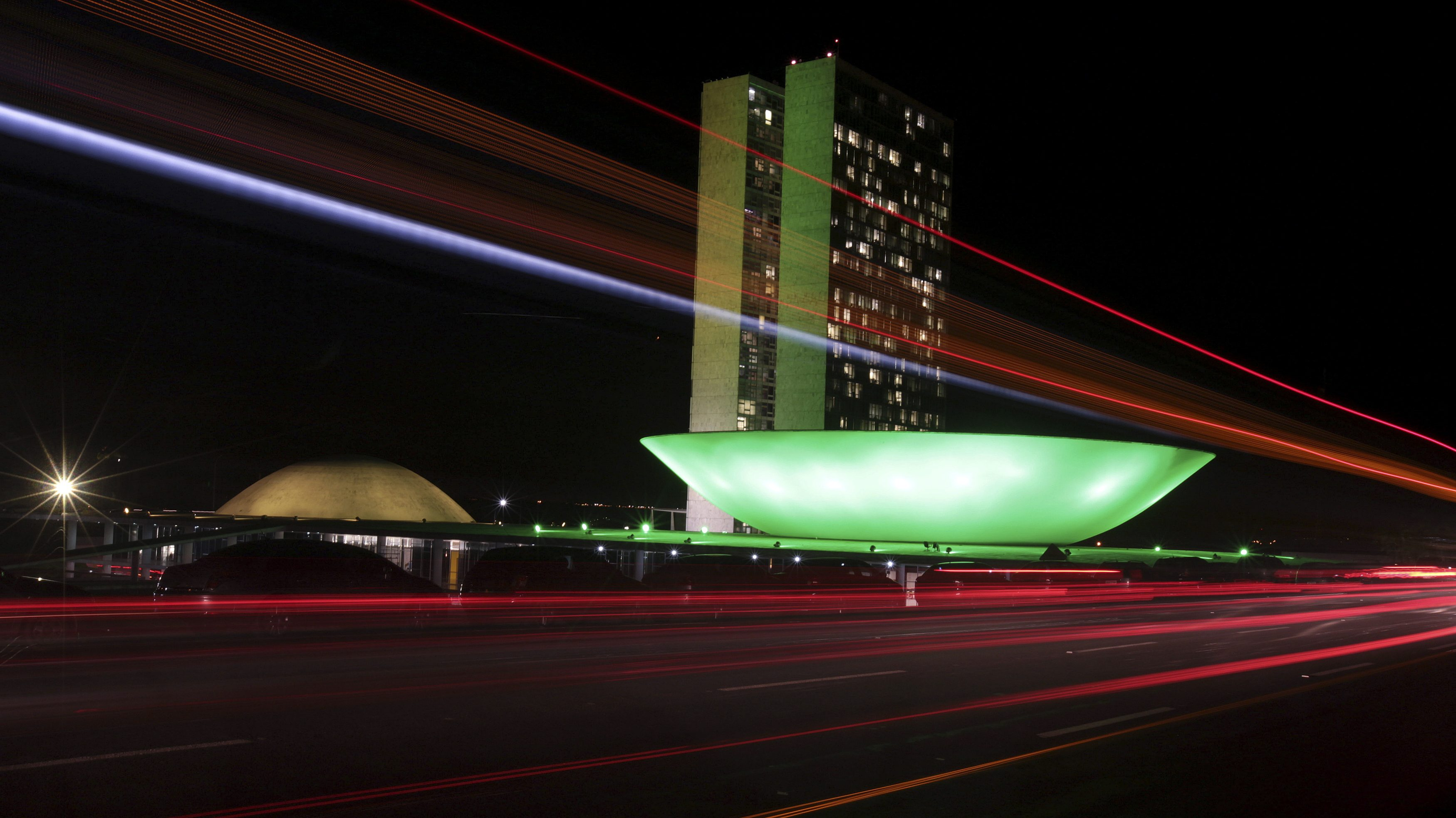 The Brazilian congress is lit up in the colours of the Brazilian national flag ahead of the 2014 World Cup, in Brasilia June 2, 2014.