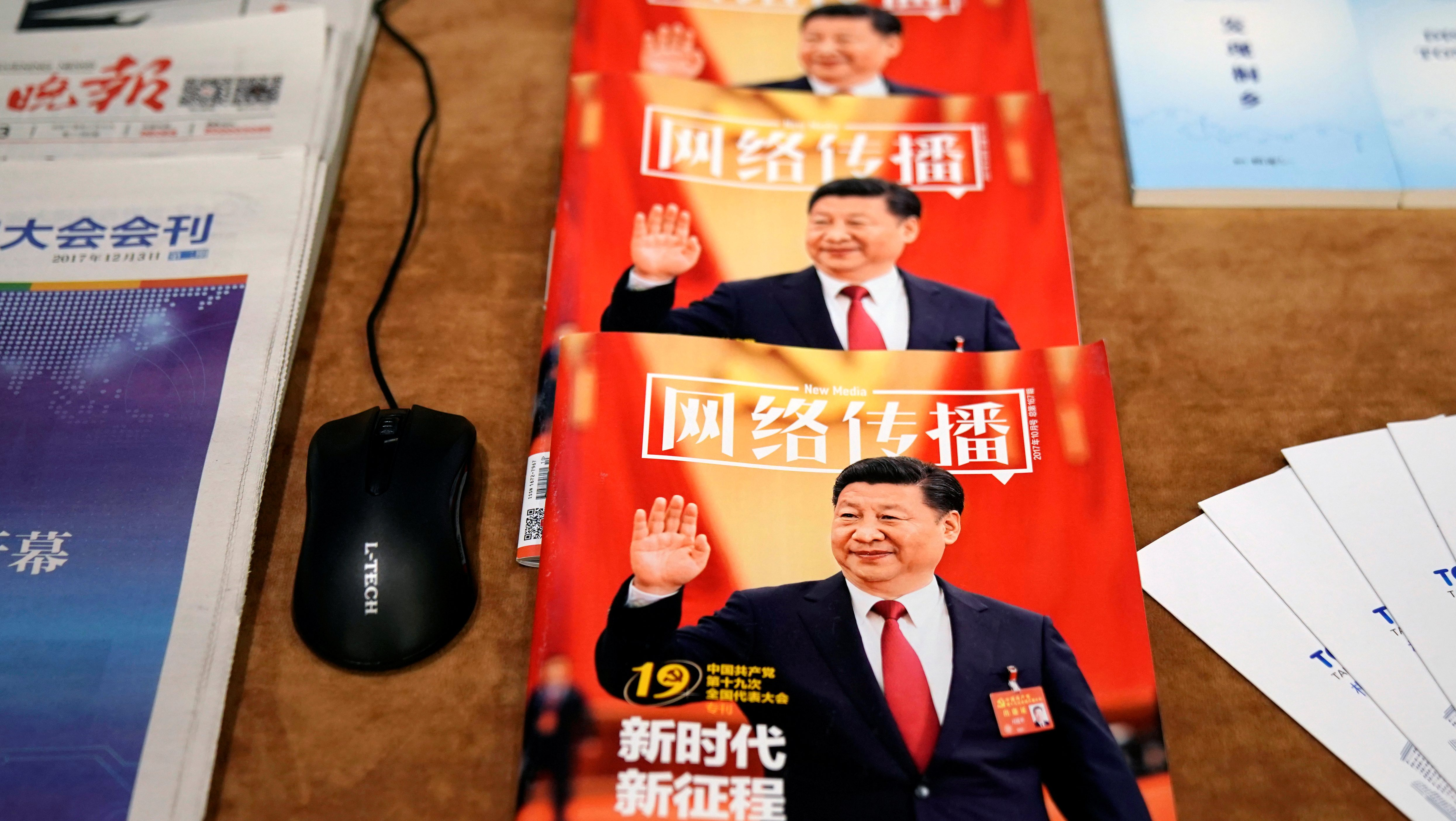 Chinese magazines featuring China's President Xi Jinping on the cover are seen during the fourth World Internet Conference in Wuzhen, Zhejiang province, China, December 3, 2017. REUTERS/Aly Song