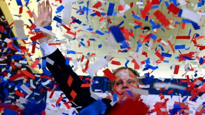 Democratic candidate for U.S. Senate Doug Jones waves as confetti falls before speaking during an election-night watch party Tuesday, Dec. 12, 2017, in Birmingham, Ala. Jones is facing Republican Roy Moore.