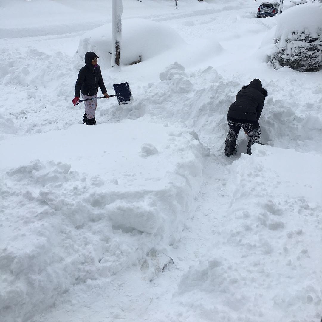 People dig out after the record snowfall in Erie, U.S., December 26, 2017 in this picture obtained from social media. Courtesy of Instagram @DANIELLESOFANCY /via REUTERS THIS IMAGE HAS BEEN SUPPLIED BY A THIRD PARTY. MANDATORY CREDIT. NO RESALES. NO ARCHIVES - RC1A000A9920