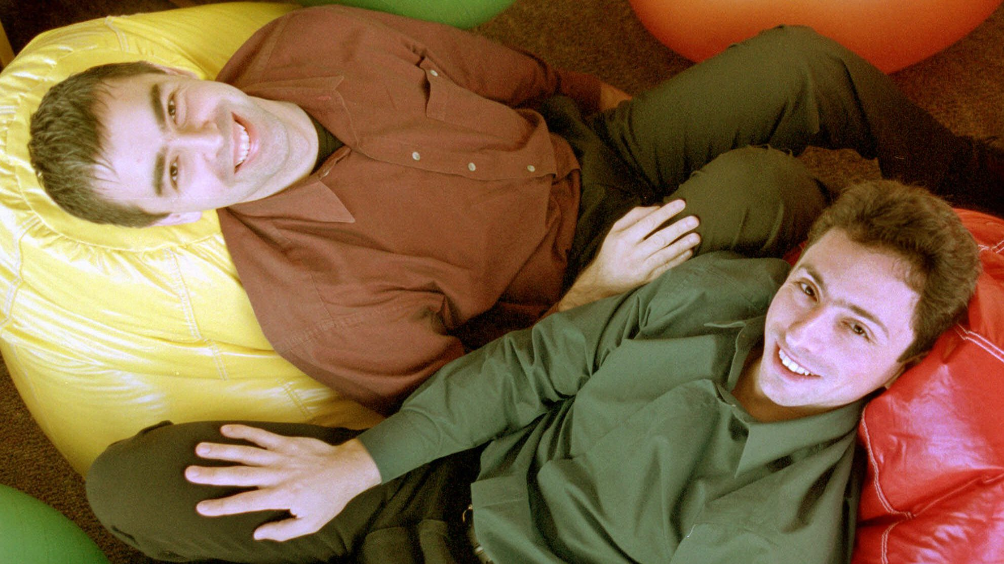 Google's co-founders, CEO Larry Page, left, and Chairman Sergey Brin, rest on bean bags at Google's headquarters on Friday, Nov. 11, 2000, in Mountain View, Calif.   Google  which replaced Inktomi as Yahoo's search engine in June  is one of the few search engines that shuns pay-for-position and pay-for-inclusion. Google executives say those formulas make it more difficult for people to find potentially valuable information, like cancer research, on the Web.     ``We have taken a very strong stance that our search results represent our editorial integrity,'' said Google CEO Larry Page.