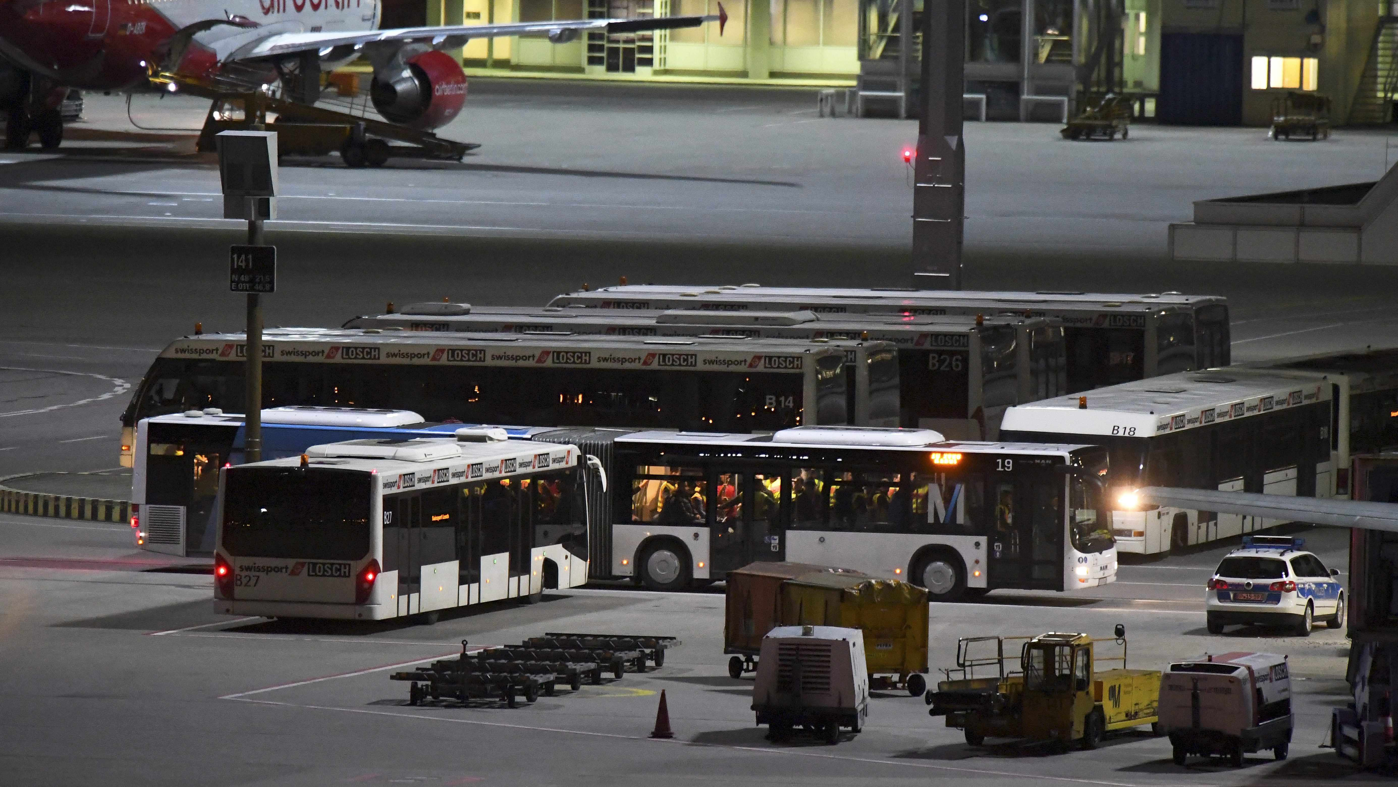 epa05809195 Busses stand next to an airplane to take in refugees who are being deported to Afghanistan, at the airport of Munich, Germany, 22 February 2017. According to reports, Germany was set to carry out another deportation of some 50 rejected asylum seekers to Afghanistan, a move that has sparked criticism from opposition parties and activist groups.  EPA/SEBASTIAN WIDMANN