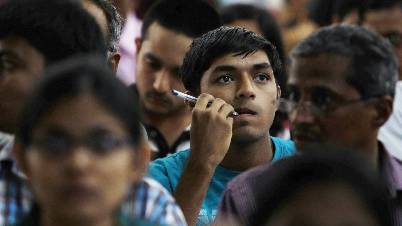 A successful candidate watches a screen displaying alloted seats to students as he waits eagerly to secure his engineering seat, after qualifying the Common Entrance Test, in Bangalore, India, Thursday, July 7, 2011. The Common Entrance Test is a competitive exam conducted for the admission of students to the first year or first semester of full time courses in medical, dental and engineering courses in professional colleges.