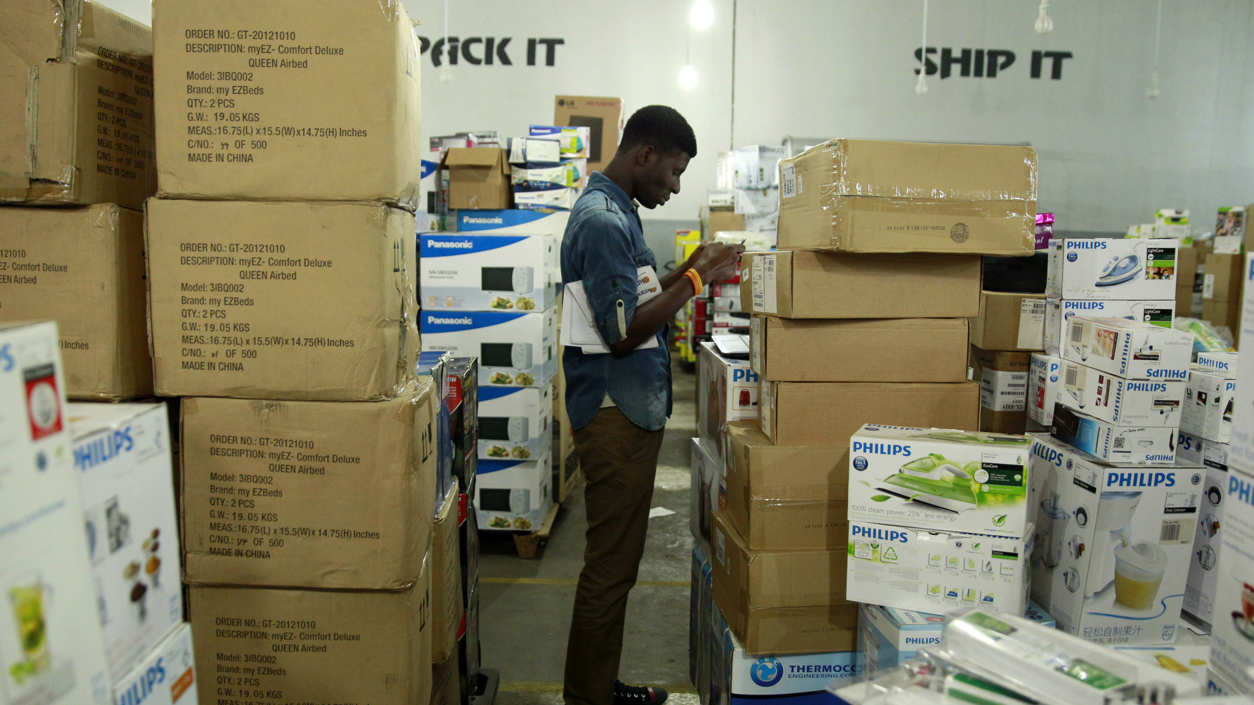 A staff member takes stock of goods at the warehouse of Konga online shopping company in Ilupeju district in Nigeria's commercial capital Lagos September 13, 2013.