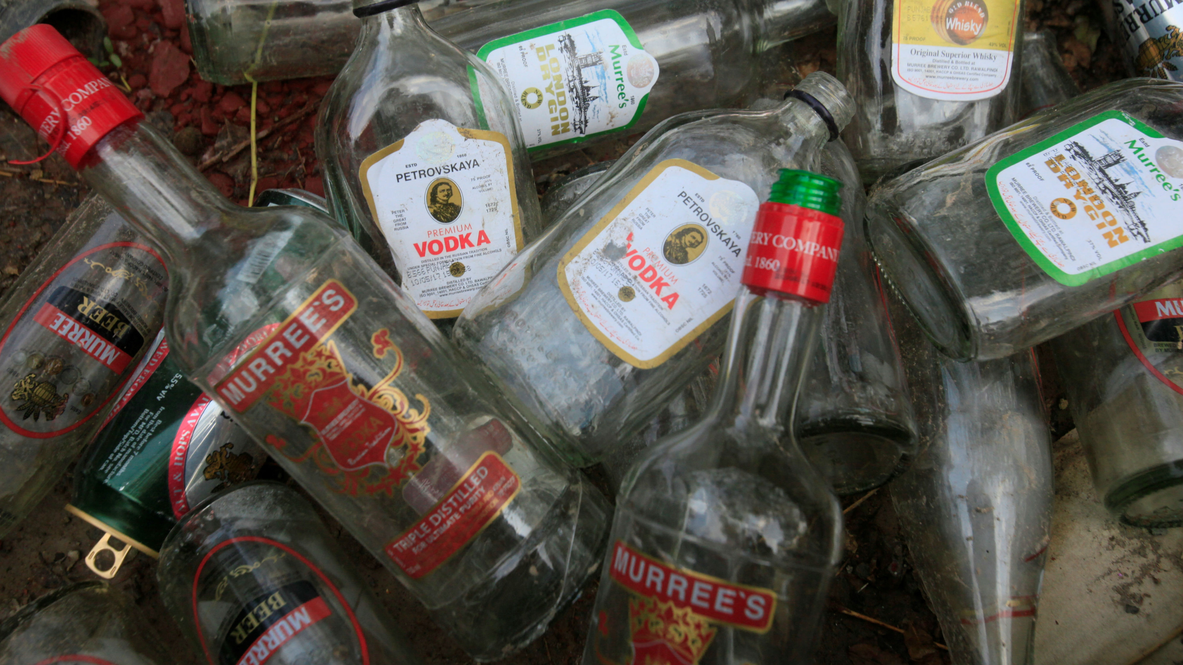 Empty liquor bottles in a pile.