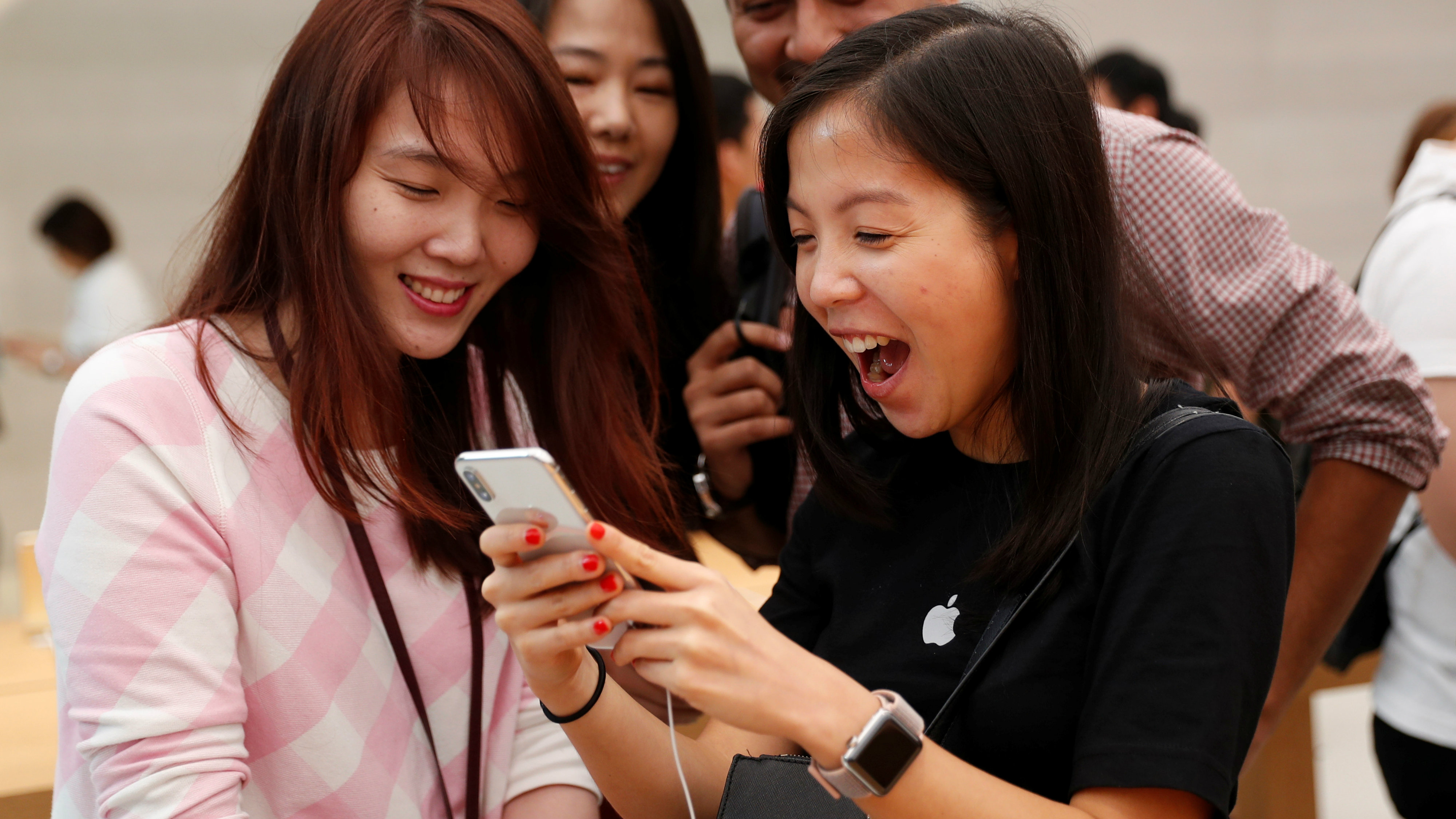 People look at iPhone X at the Apple store in Singapore