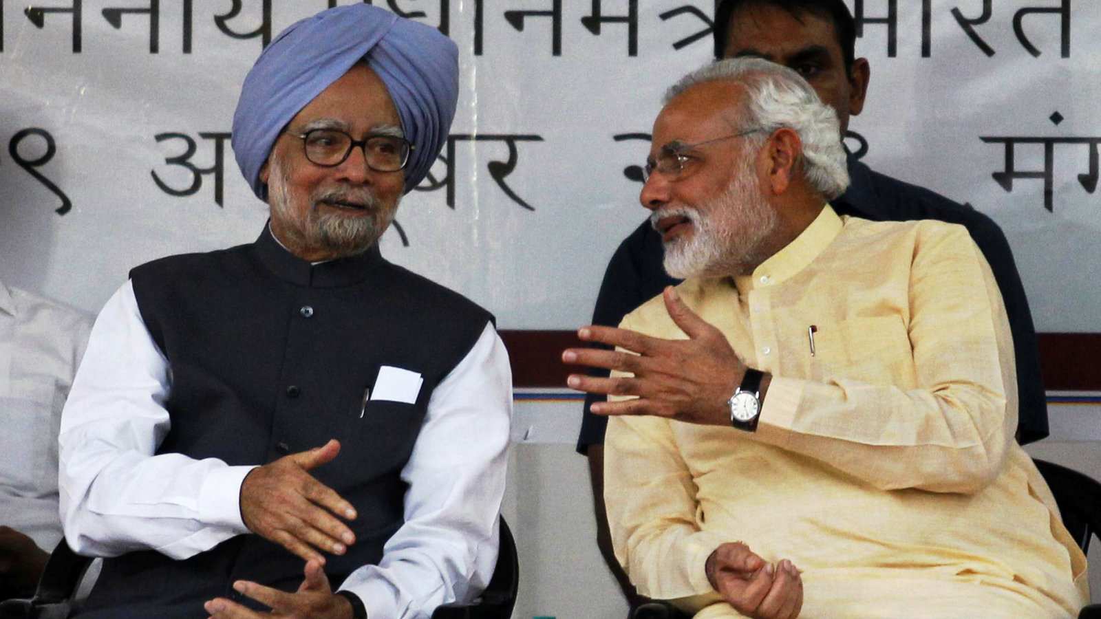 Former Indian prime minister Manmohan Singh with current prime minister Narendra Modi in Ahmedabad in 2013.
