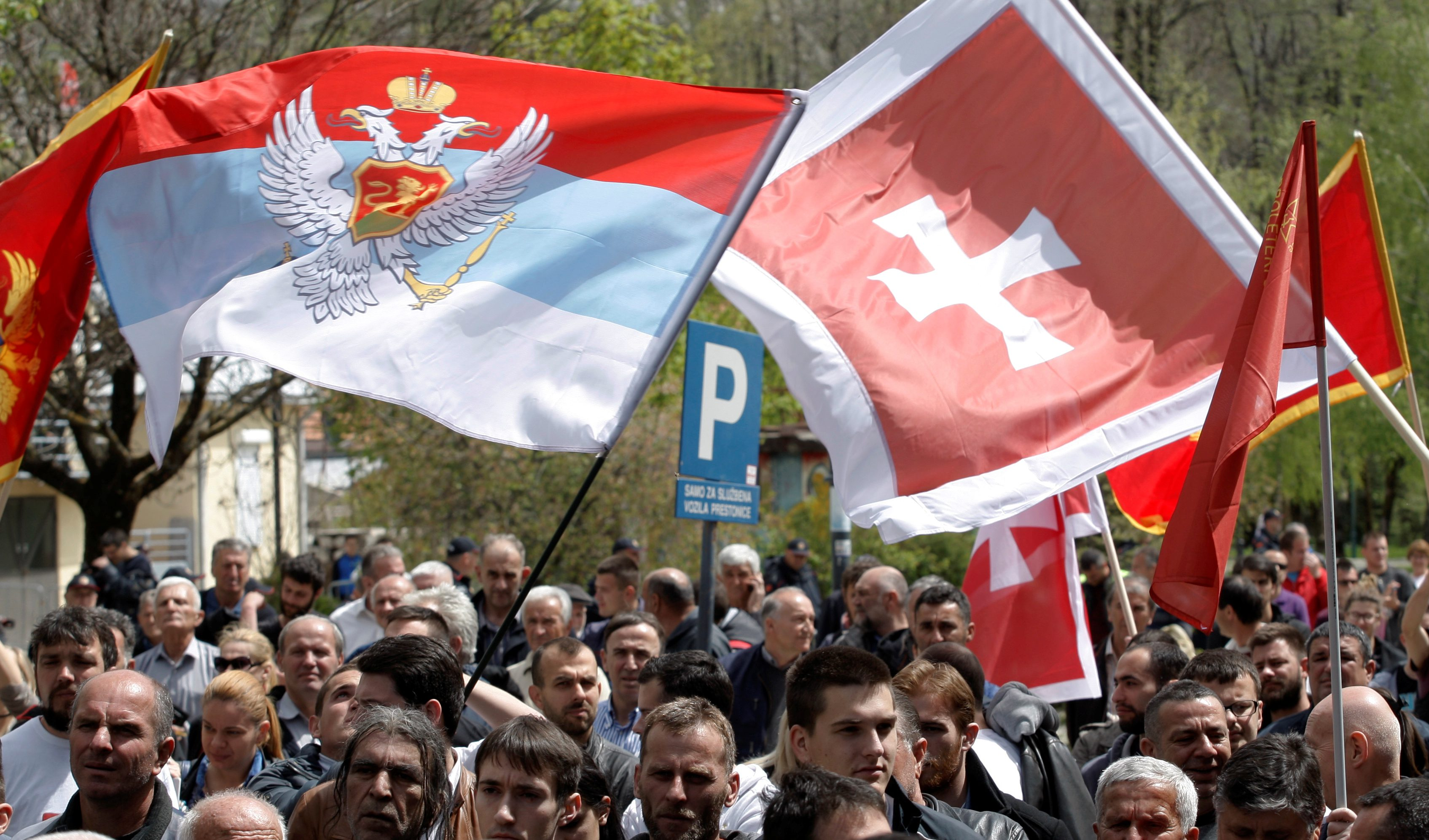 Demonstrators wave flags during anti-NATO protest as Montenegro's parliament discusses NATO membership agreement in Cetinje, Montenegro, April 28, 2017.