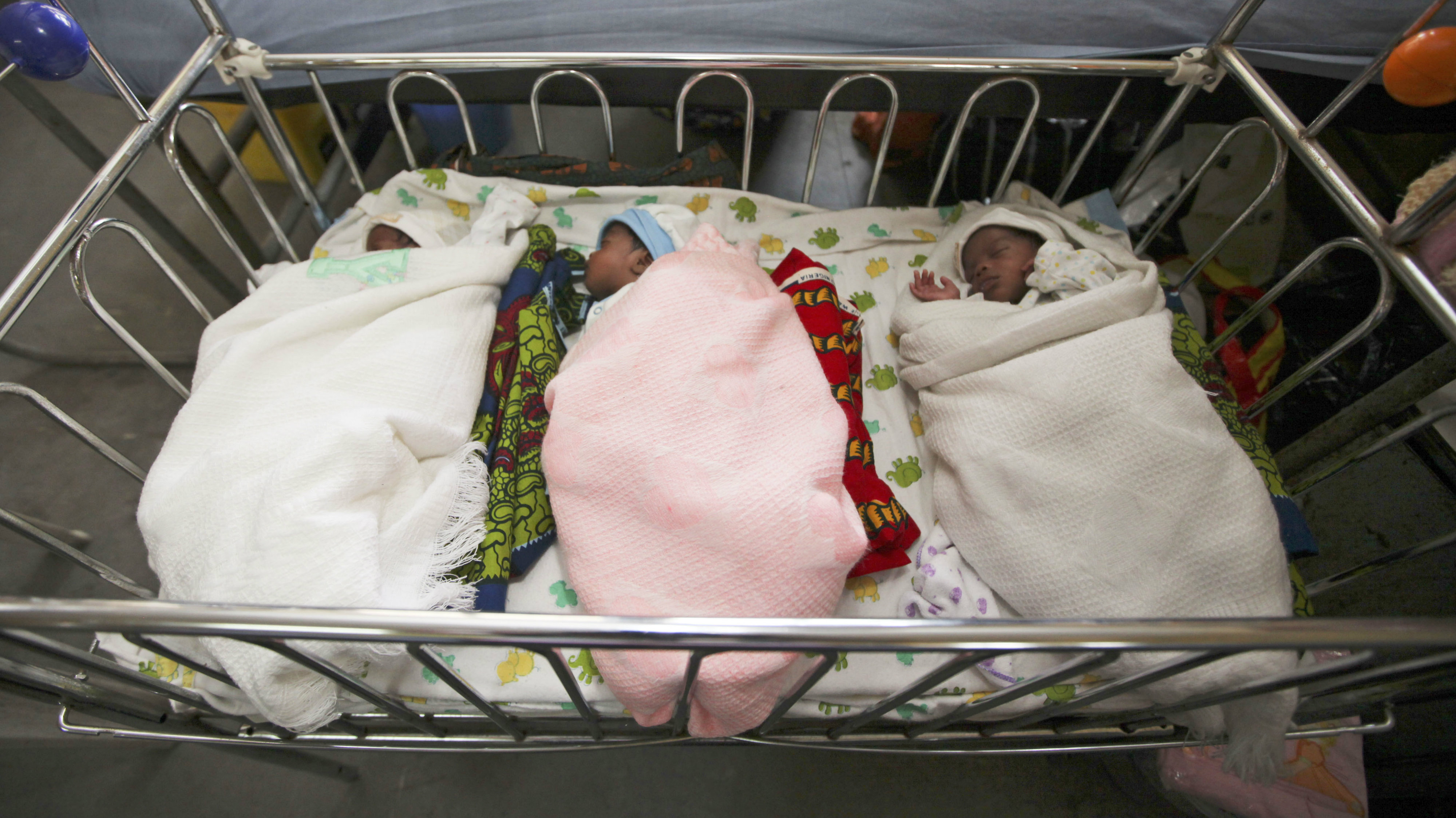 Newborn triplets Isaac, Treasure and Samuel sleep in a ward of the Lagos Island Maternity Hospital in Lagos, Nigeria, Monday, Oct. 31, 2011. Amid the millions of births and deaths around the world each day, it is impossible to pinpoint the arrival of the globe's 7 billionth occupant. But the U.N. chose Monday to mark the day with a string of festivities worldwide, and a series of symbolic 7-billionth babies being born. Nigeria is Africa's most populous country with more than 160 million people.