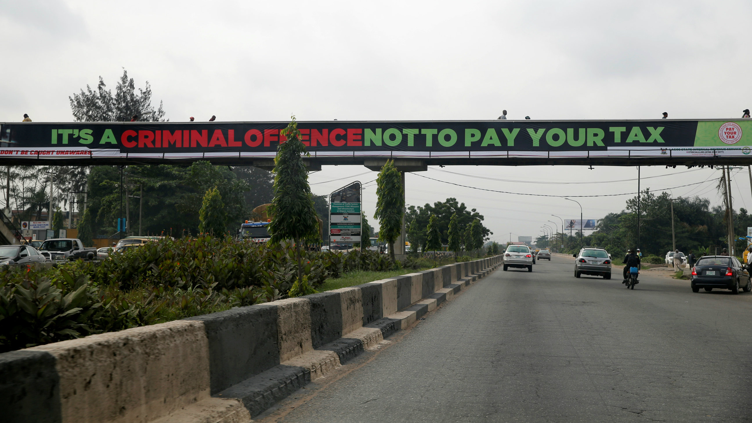 A banner campaigning for tax payment is seen hung on a pedestrian bridge across Lagos-Ibadan expressway in Nigeria's commercial capital Lagos July 22, 2016.