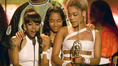 The band TLC accepting an award.